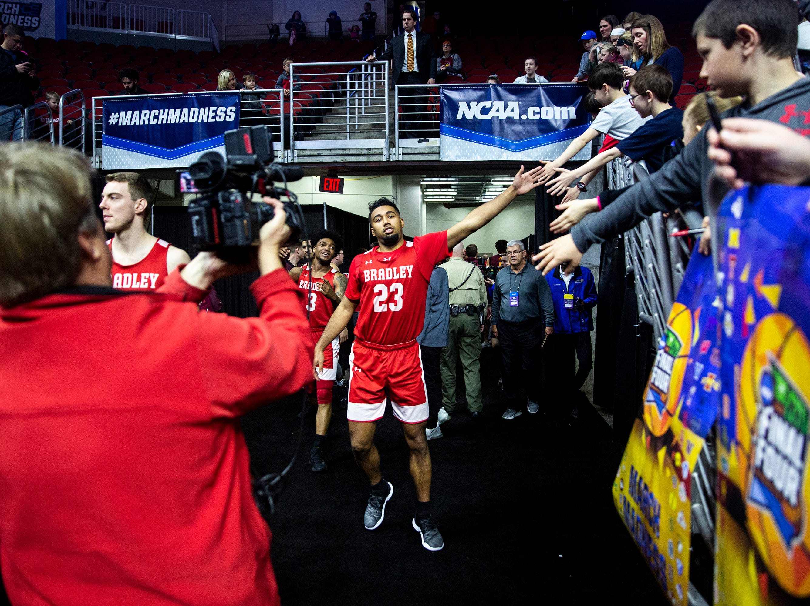Bradley's Dwayne Lautier Ogunleye gives fives to people in the stands before Bradley's open practice before the first round of the NCAA Men's Basketball Tournament on Wednesday, March 20, 2019, at Wells Fargo Arena in Des Moines, Iowa.