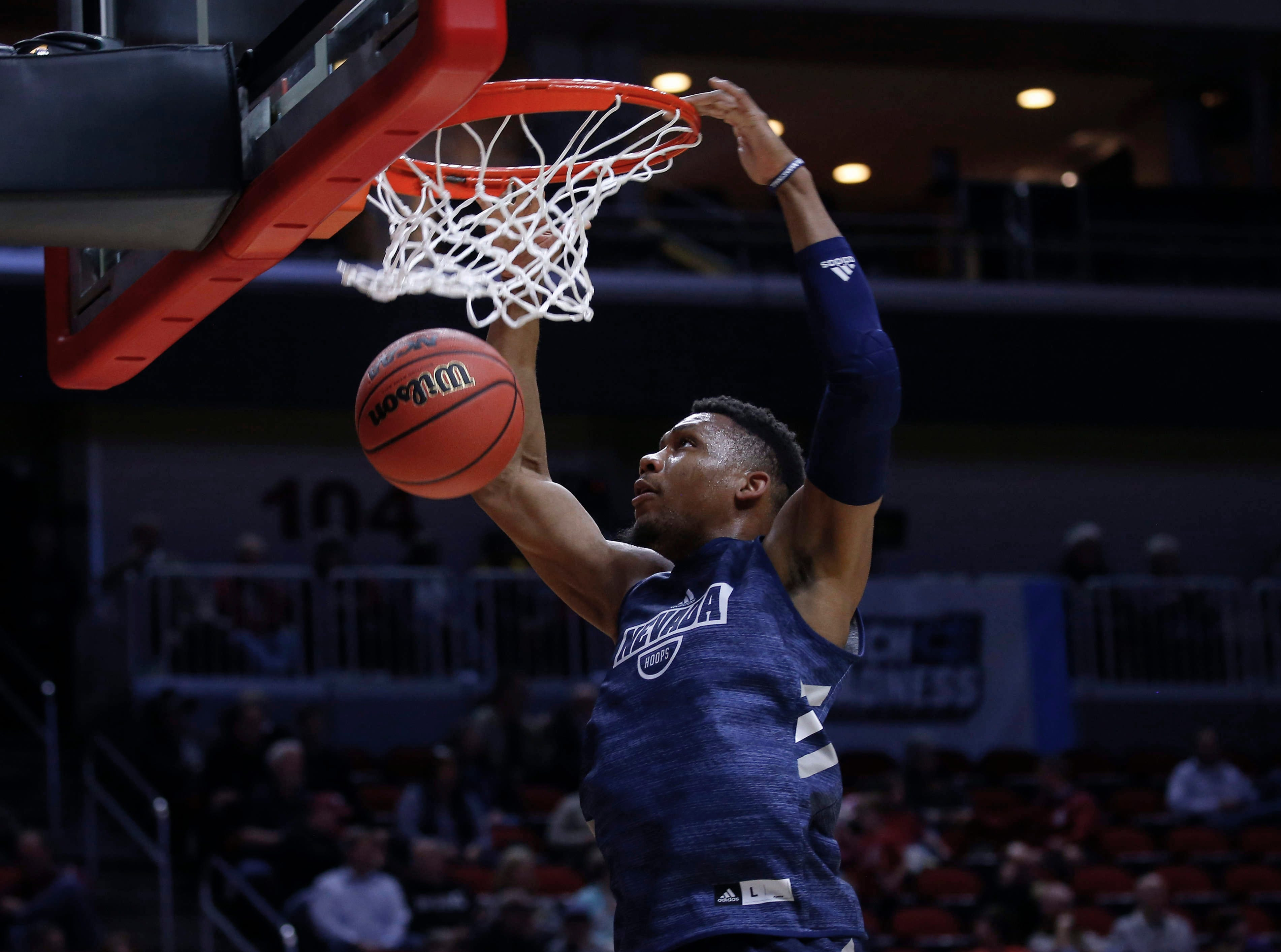 Nevada freshman Tre'Shawn Thurman dunks the ball during open practice on Wednesday, March 20, 2019, at Wells Fargo Arena in Des Moines, Iowa.