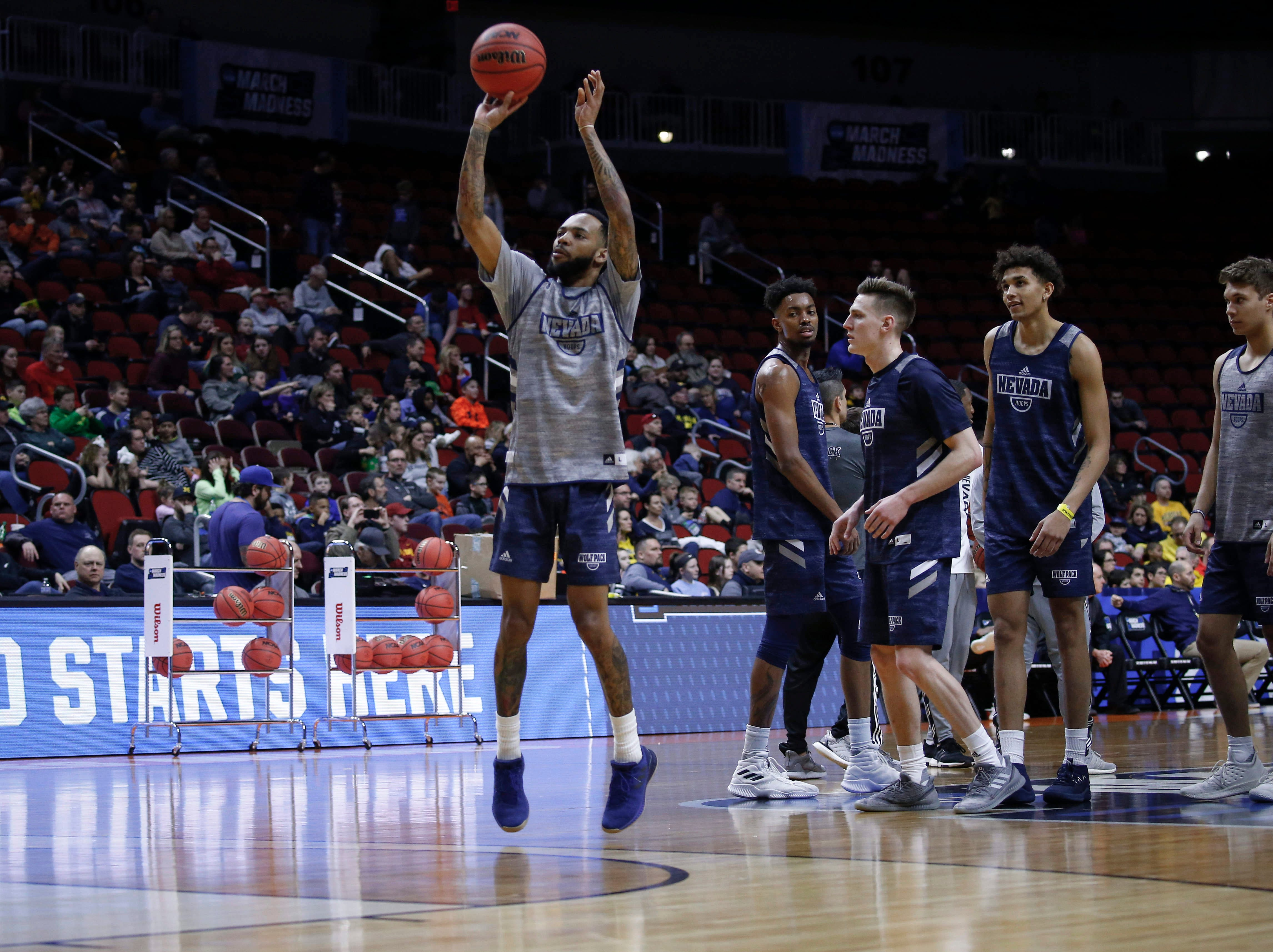 Members of the Nevada men's basketball team warm up during open practice on Wednesday, March 20, 2019, at Wells Fargo Arena in Des Moines, Iowa.