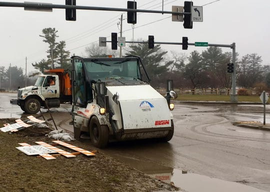 Des Moines Public Works crews remove mud from Fleur Drive on Wednesday.