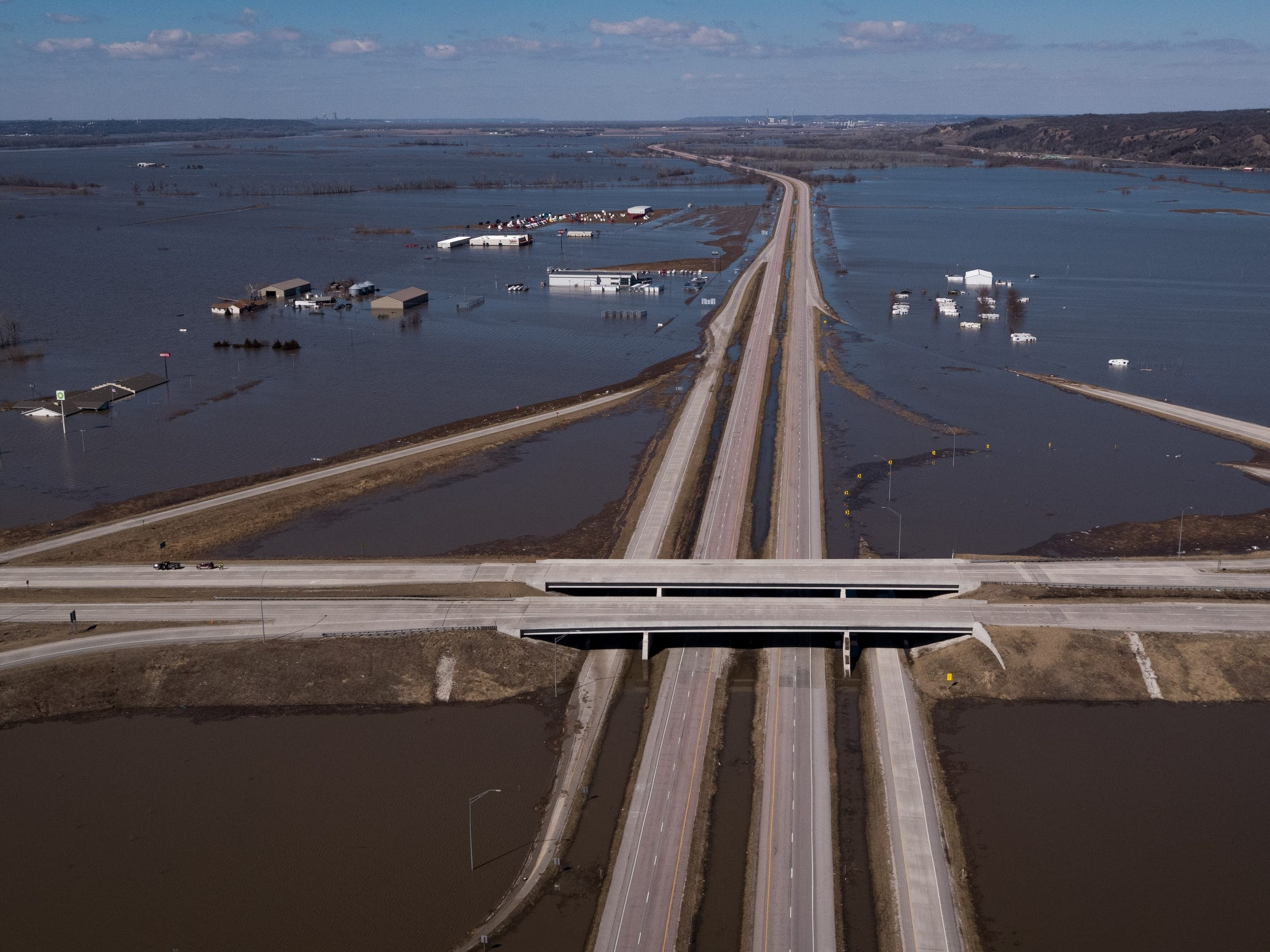 Looking north along I-29 at the intersection of Highway 34, flood waters continue to overwhelm the surrounding communities with it not expected to start to recede until later this week on Wednesday, March 20, 2019, in Mills County.