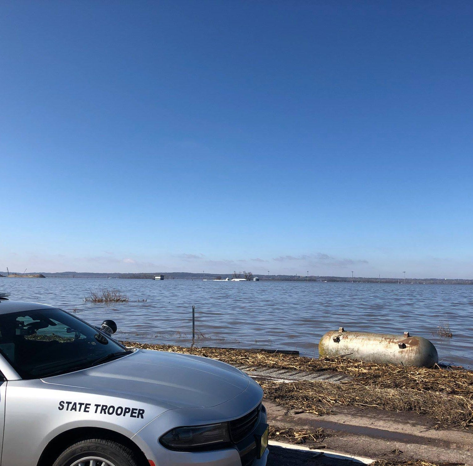 Photos and video taken by Iowa State Patrol troopers on Wednesday show the aftermath of the flooding on Interstate 29 in Iowa.