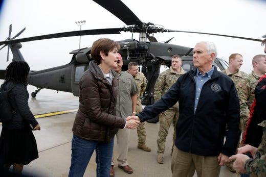Iowa Gov. Kim Reynolds takes leave of Vice President Mike Pence in Omaha, Neb., Tuesday, March 19, 2019, after they toured by helicopter areas flooded by the Missouri River.