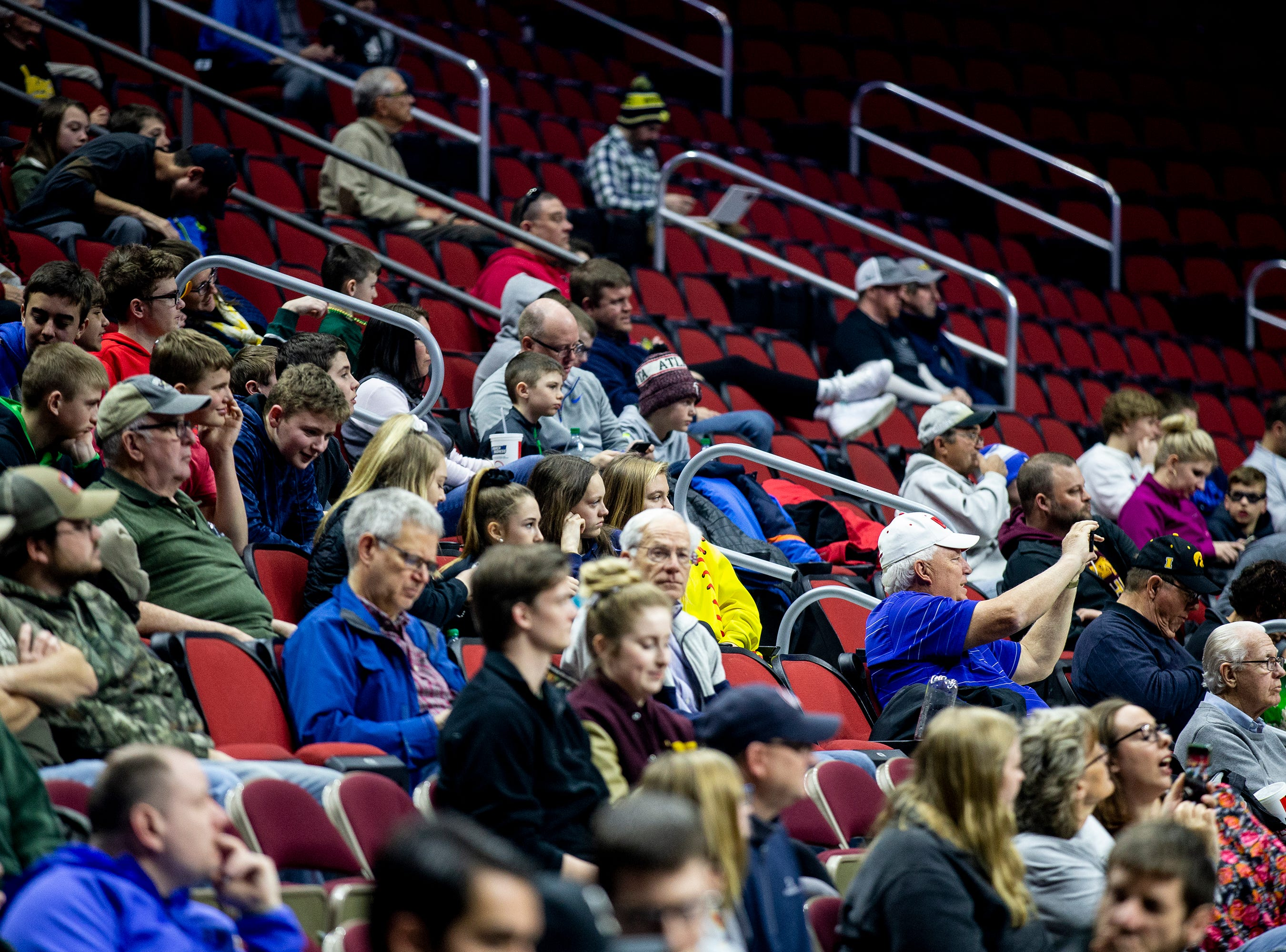 Basketball fans watch from the stands during Minnesota's open practice before the first round of the NCAA Men's Basketball Tournament on Wednesday, March 20, 2019, at Wells Fargo Arena in Des Moines, Iowa. Minnesota will face Louisville in the first round on Thursday.