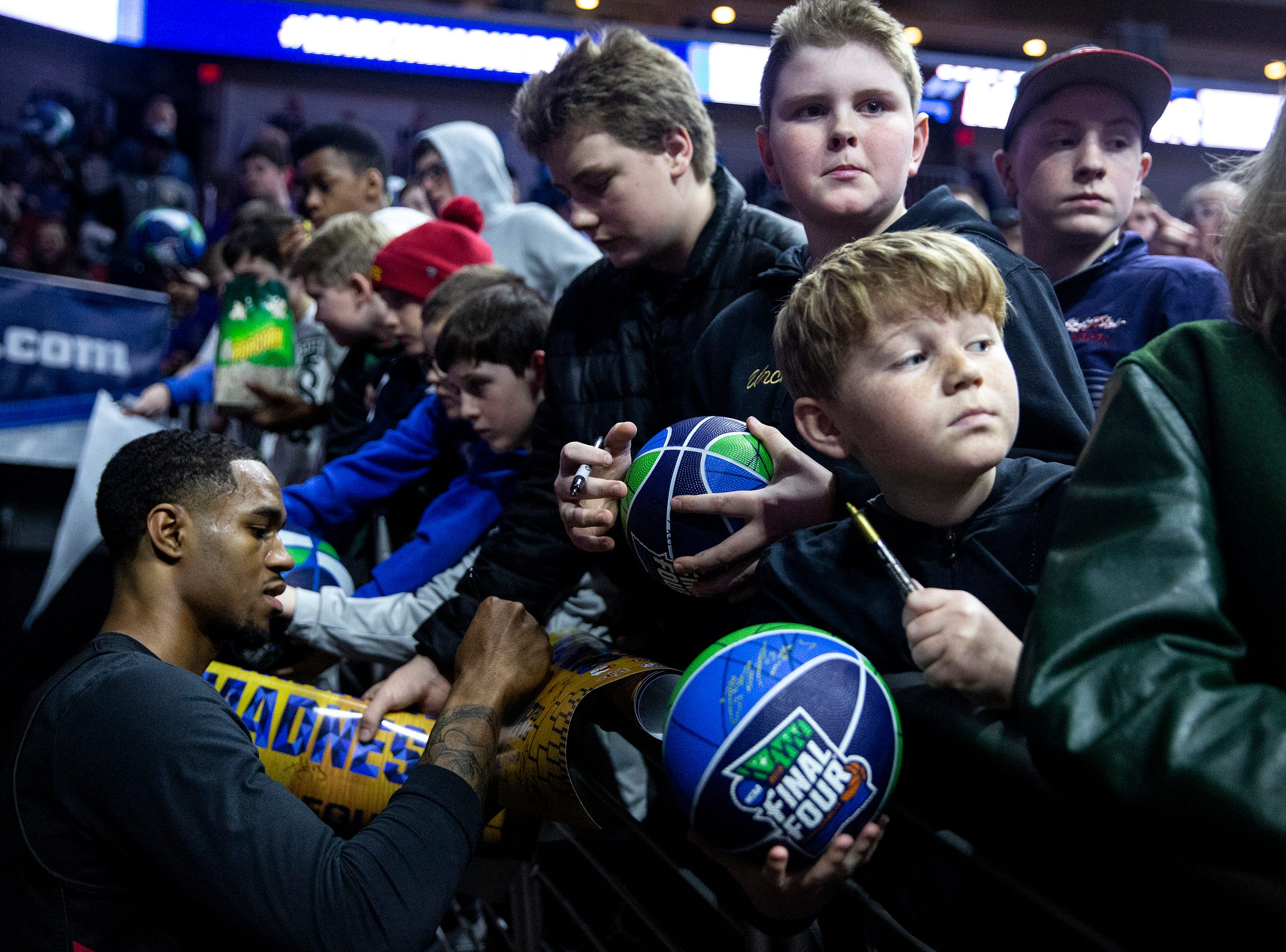 Basketball fans wait to ask players for autographs during Louisville's open practice before the first round of the NCAA Men's Basketball Tournament on Wednesday, March 20, 2019, at Wells Fargo Arena in Des Moines, Iowa.