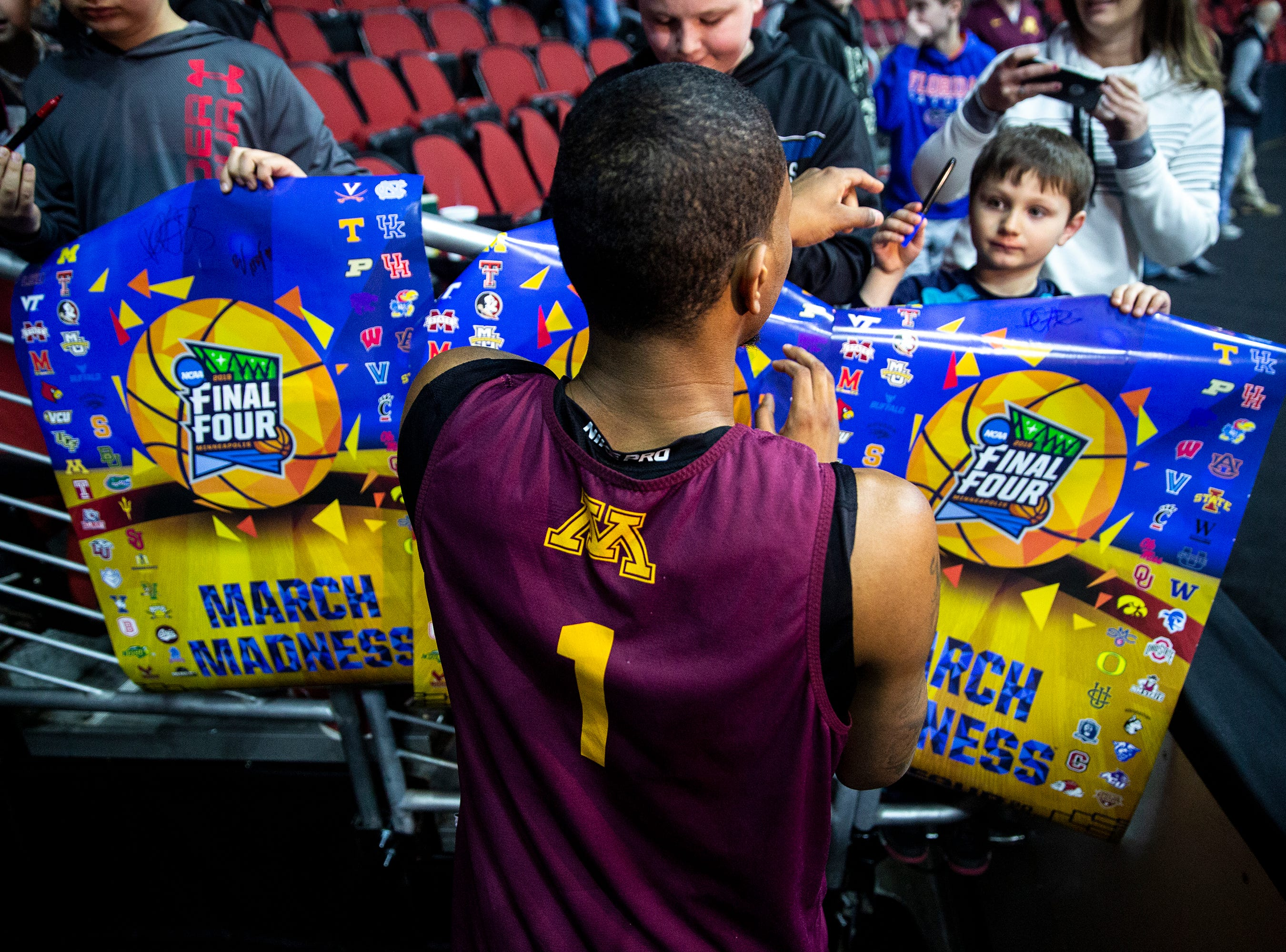 Minnesota's Dupree McBrayer signs autographs after Minnesota's open practice before the first round of the NCAA Men's Basketball Tournament on Wednesday, March 20, 2019, at Wells Fargo Arena in Des Moines, Iowa. Minnesota will face Louisville in the first round on Thursday.