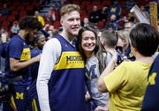 Michigan freshman Ignas Brazdeikis poses for a photo with a fan after open practice on Wednesday, March 20, 2019, at Wells Fargo Arena in Des Moines, Iowa.