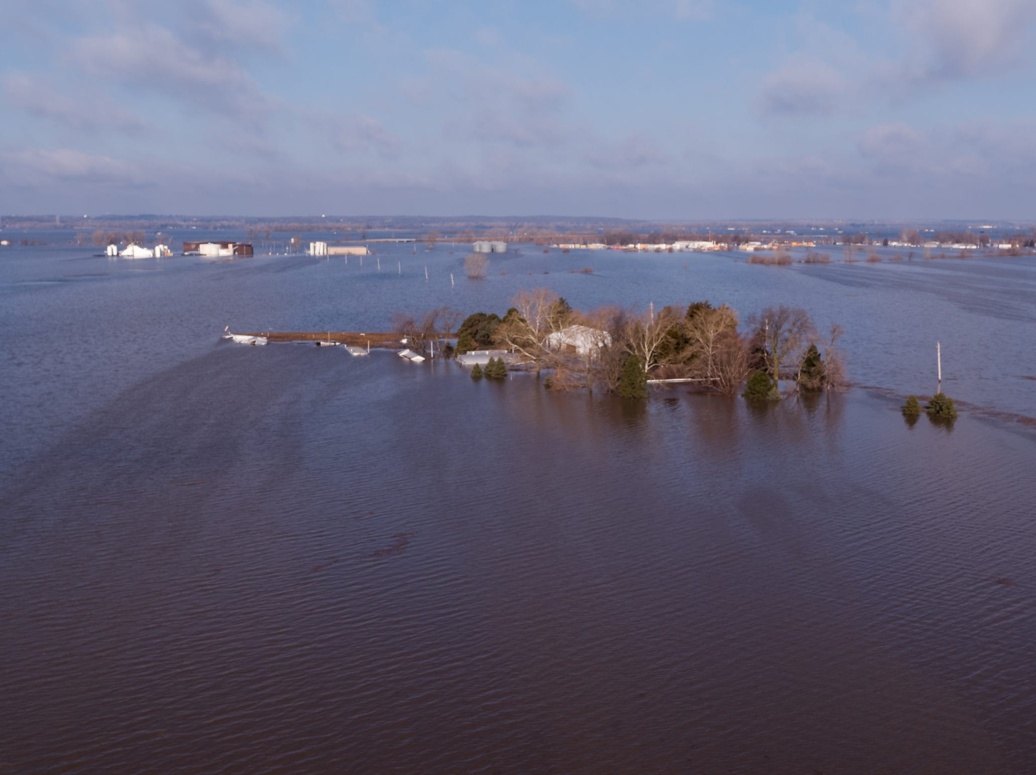 Flood waters surround homes and farmland outside of Glenwood on Wednesday, March 20, 2019.