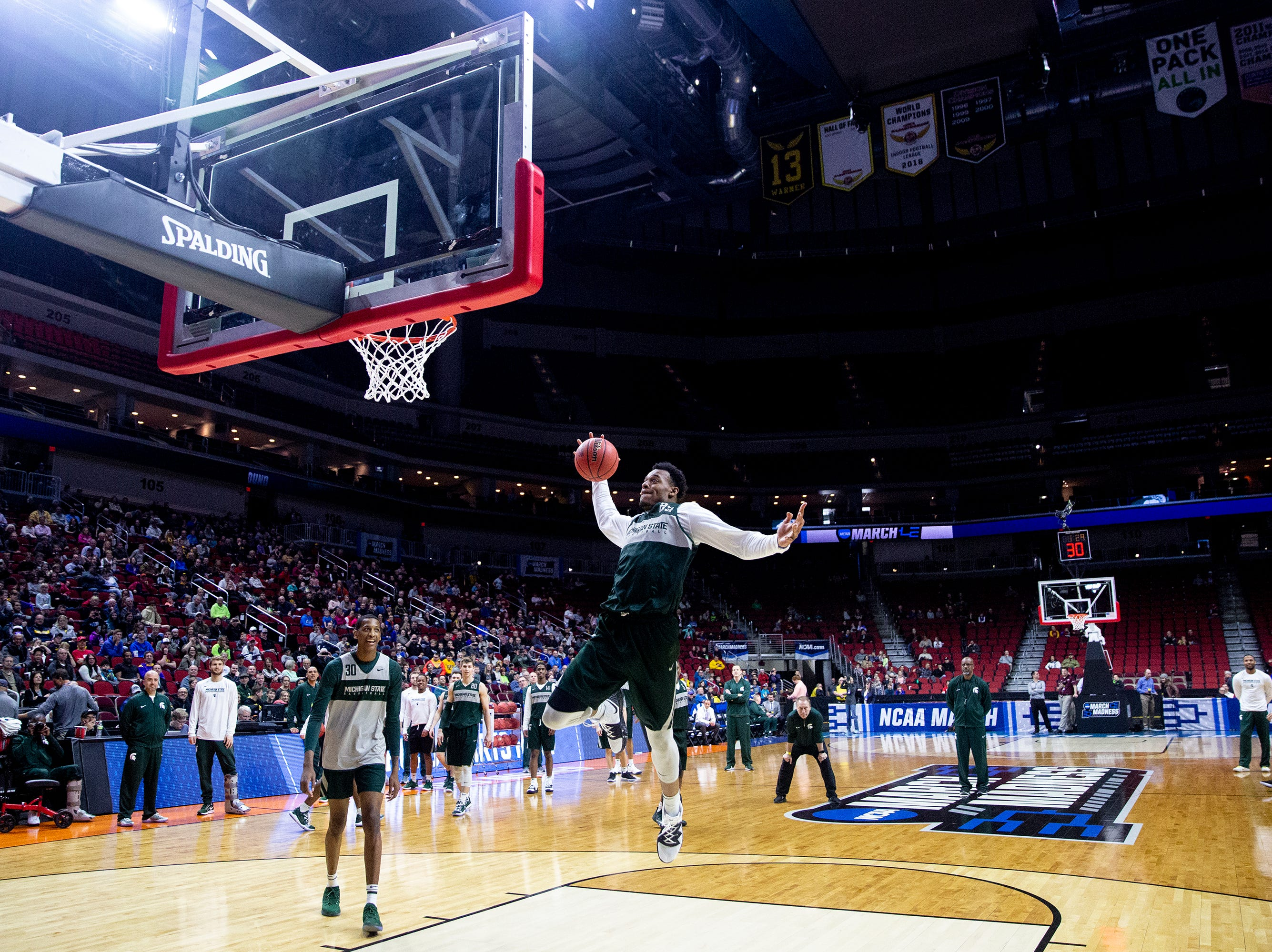 Michigan State's Xavier Tillman attempts a trick shot during Michigan State's open practice before the first round of the NCAA Men's Basketball Tournament on Wednesday, March 20, 2019, at Wells Fargo Arena in Des Moines, Iowa.