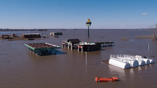 Flood waters overtake two gas stations at the intersection of Highway 34 and Interstate 29 on Wednesday, March 20, 2019, in Mills County.