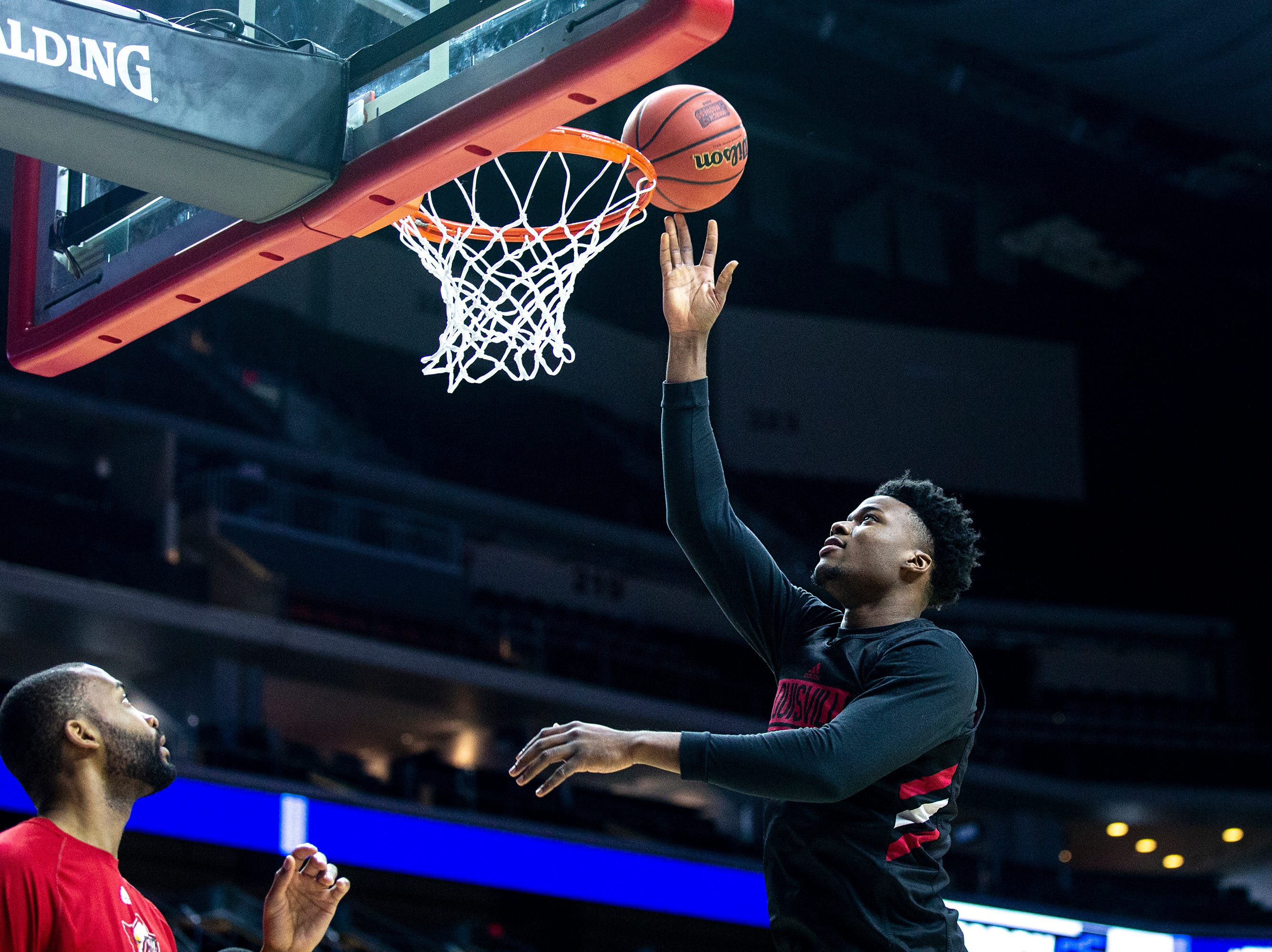 Louisville's Steven Enoch shoot a lay-up during Louisville's open practice before the first round of the NCAA Men's Basketball Tournament on Wednesday, March 20, 2019, at Wells Fargo Arena in Des Moines, Iowa.