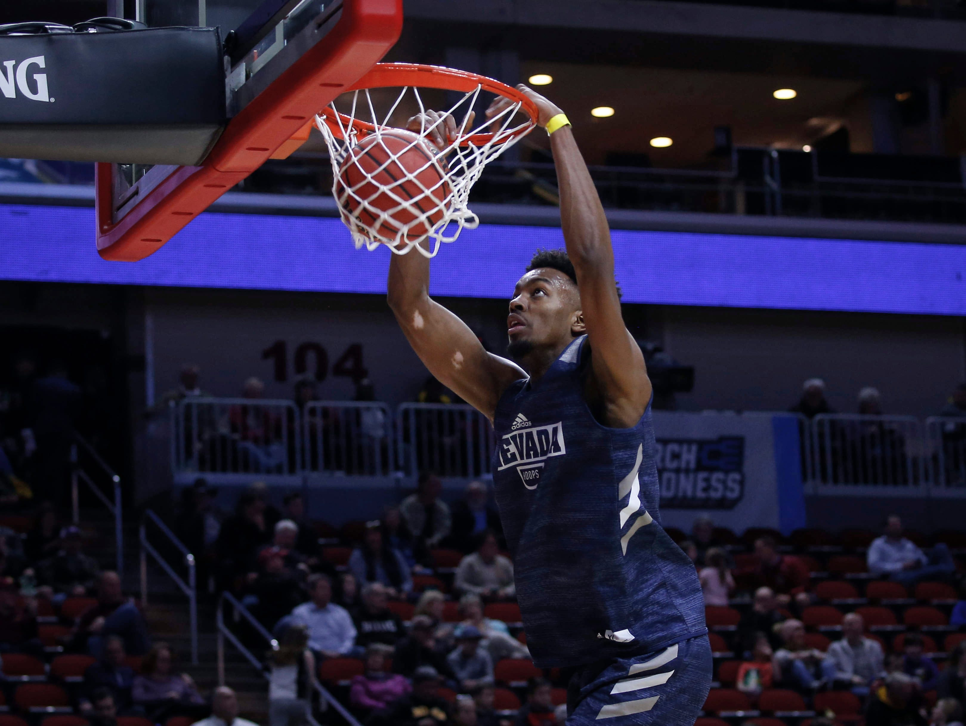 Nevada freshman Jordan Brown dunks the ball during open practice on Wednesday, March 20, 2019, at Wells Fargo Arena in Des Moines, Iowa.
