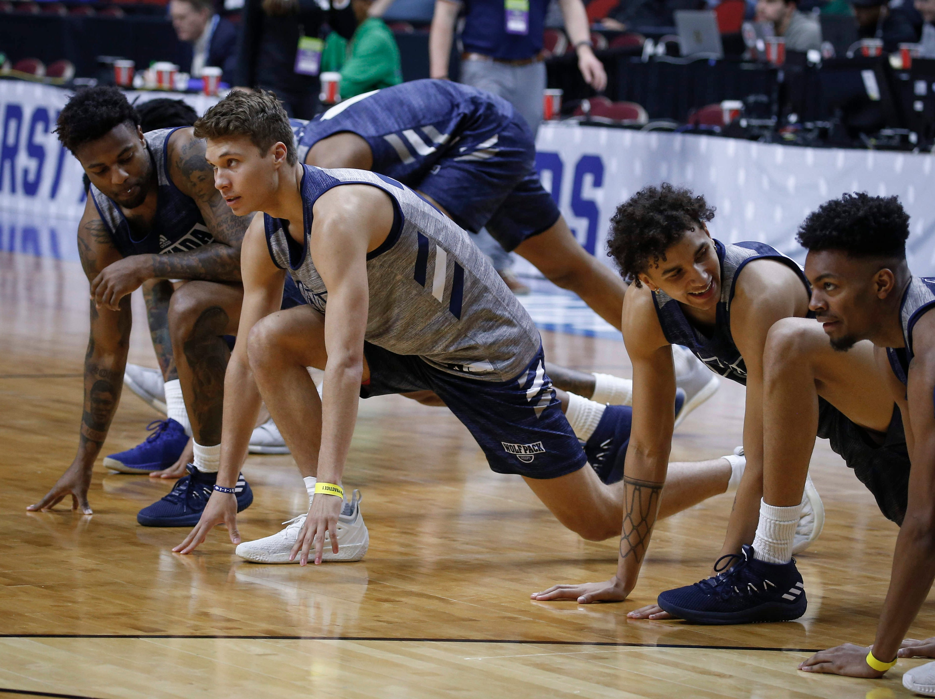 Members of the Nevada basketball team warm up prior to the start of practice on Wednesday, March 20, 2019, at Wells Fargo Arena in Des Moines, Iowa.