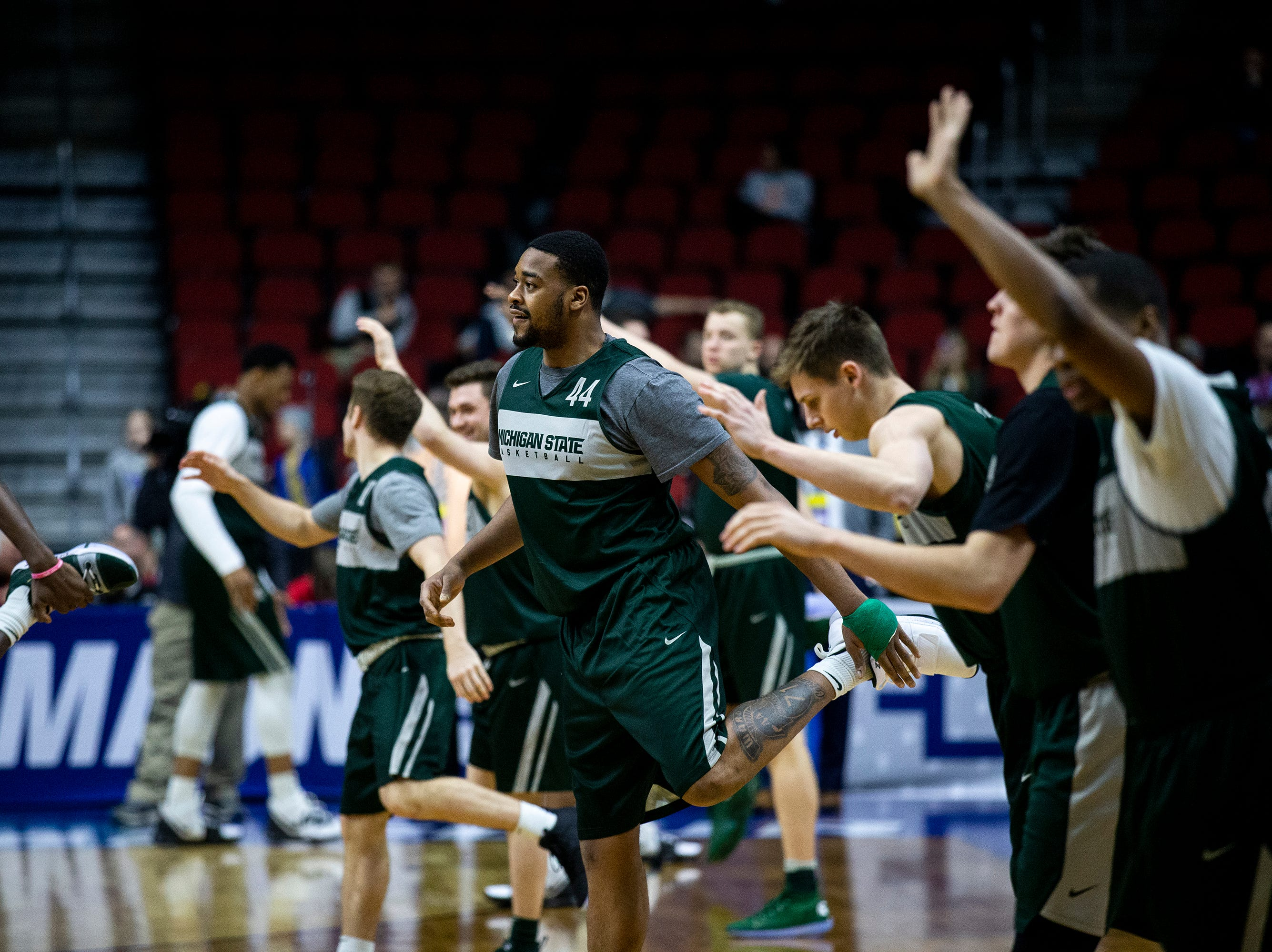 Michigan State's Nick Ward stretches during Michigan State's open practice before the first round of the NCAA Men's Basketball Tournament on Wednesday, March 20, 2019, at Wells Fargo Arena in Des Moines, Iowa.