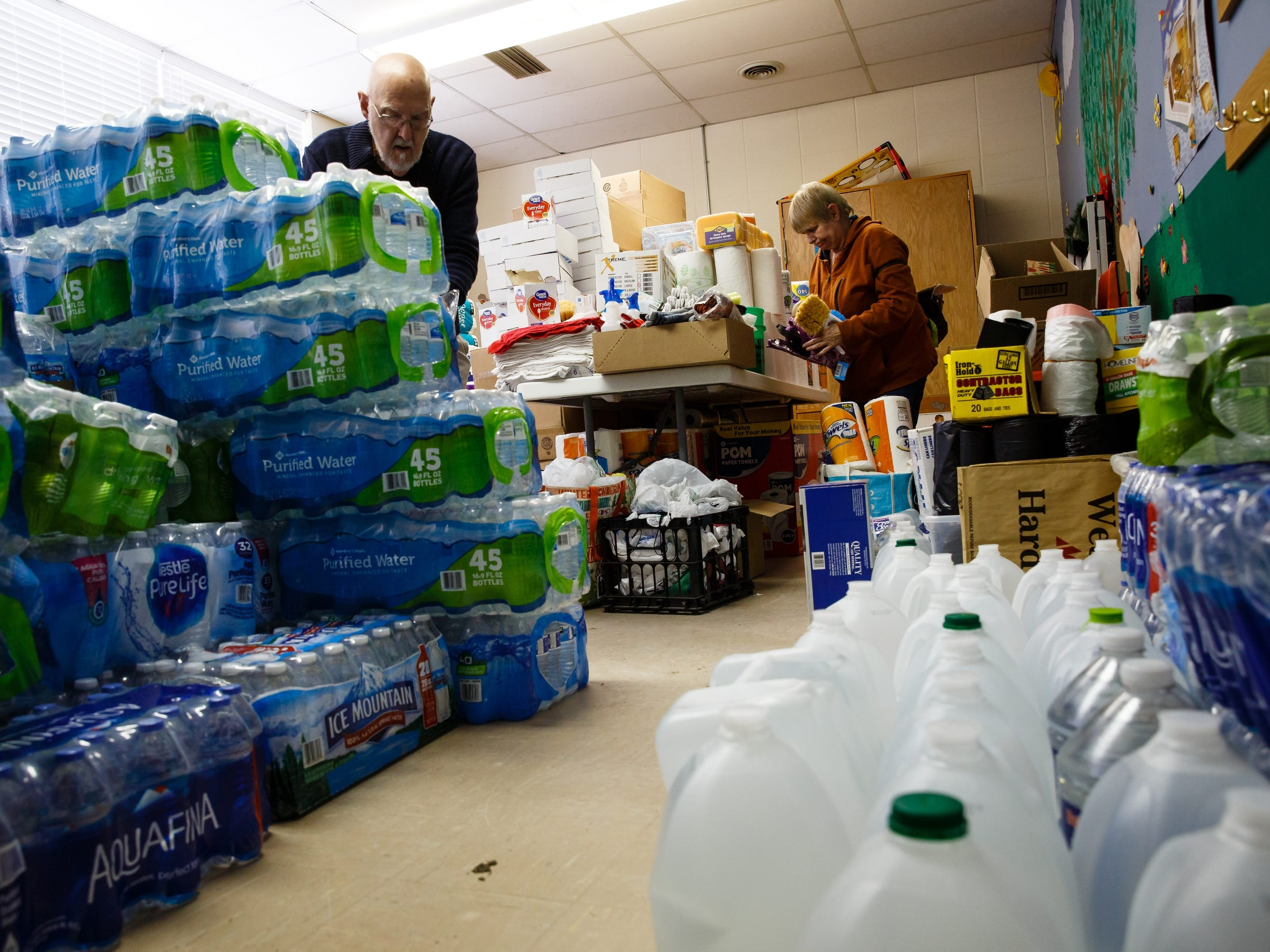 Mills County residents sort through donations of water and other supplies for victims of the rising flood waters along the Missouri River on Wednesday, March 20, 2019, in Glenwood.