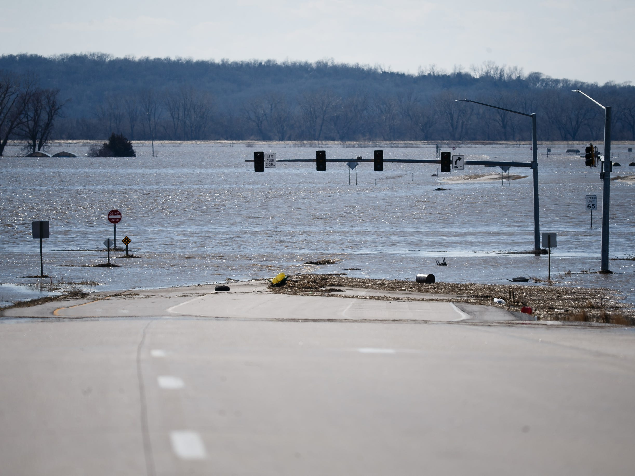 Highway 34 disappears into flood waters just west of I-29 on Wednesday, March 20, 2019, in Mills County. Flood water have shut down parts of Interstate 29 from Council Bluffs to the Missouri border and Highway 35 to the Nebrasak border