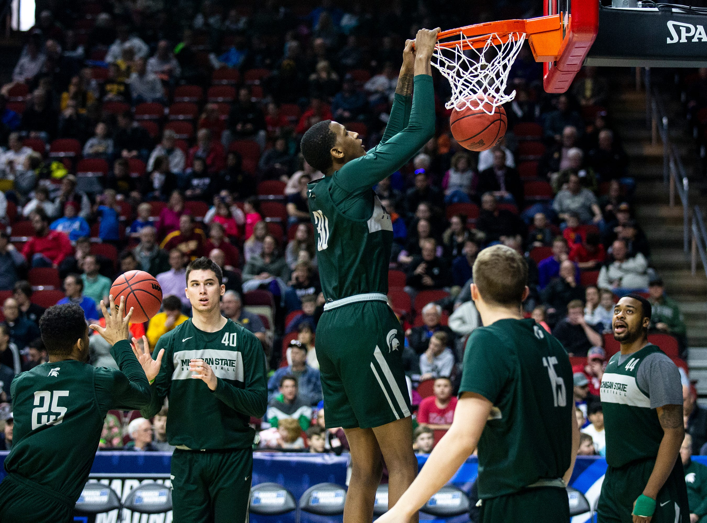 Michigan State's Marcus Bingham Jr. dunks the ball during Michigan State's open practice before the first round of the NCAA Men's Basketball Tournament on Wednesday, March 20, 2019, at Wells Fargo Arena in Des Moines, Iowa.
