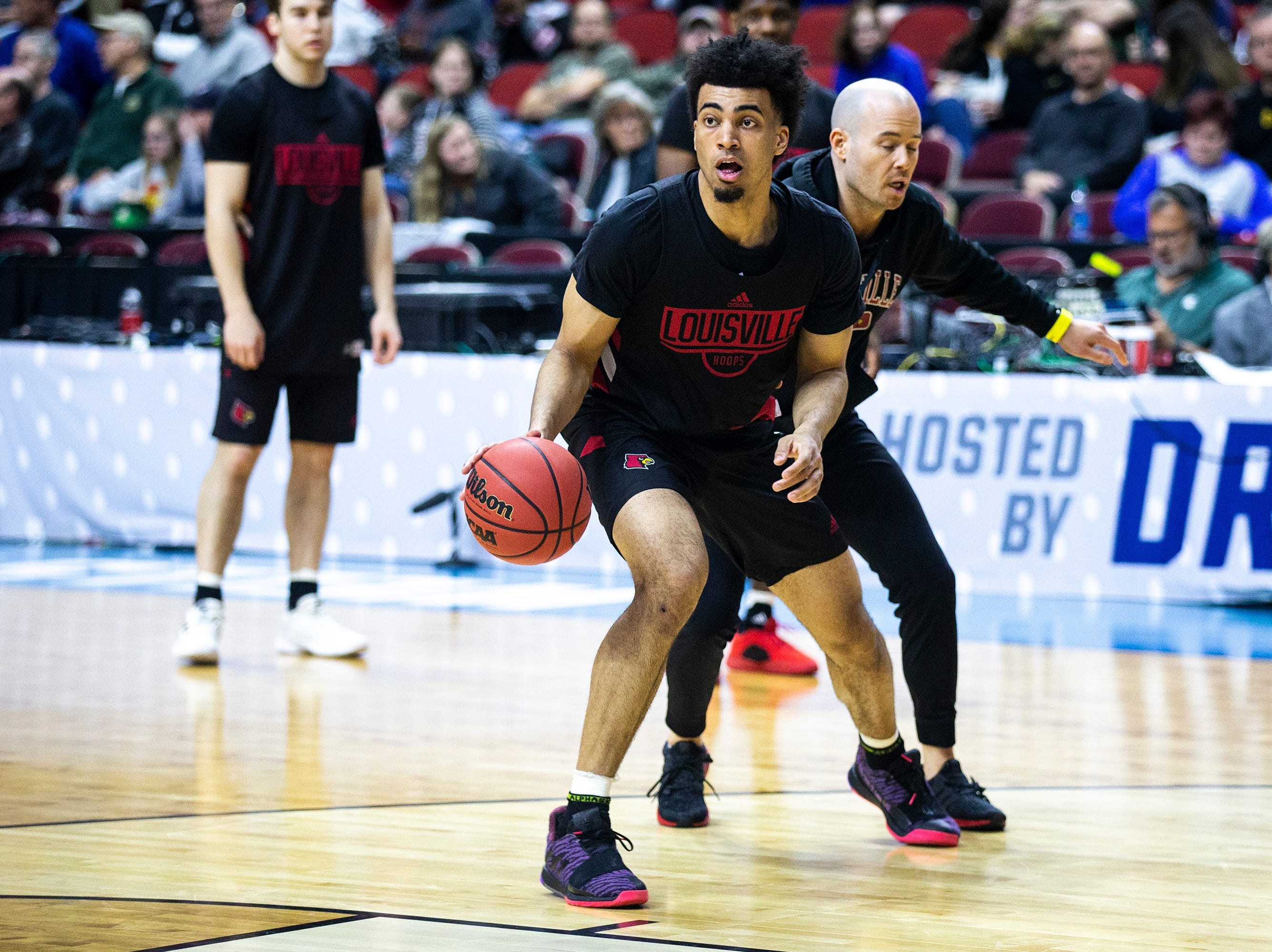 Louisville's Jordan Nwora  runs through a practice drill during Louisville's open practice before the first round of the NCAA Men's Basketball Tournament on Wednesday, March 20, 2019, at Wells Fargo Arena in Des Moines, Iowa.