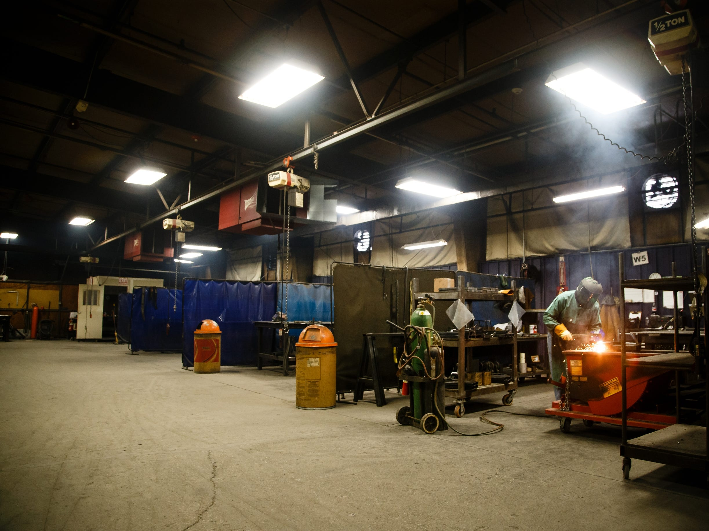 Employees at AAI work at the companies facility in Jefferson on Wednesday, March 13, 2019. AAI is the official supplier of basketball back stops for NBA, NCAA, WNBA and the NBA G-League. They make all their products, as well as a full line of gymnastics and tumbling equipment out of this factory in Jefferson where they were founded.