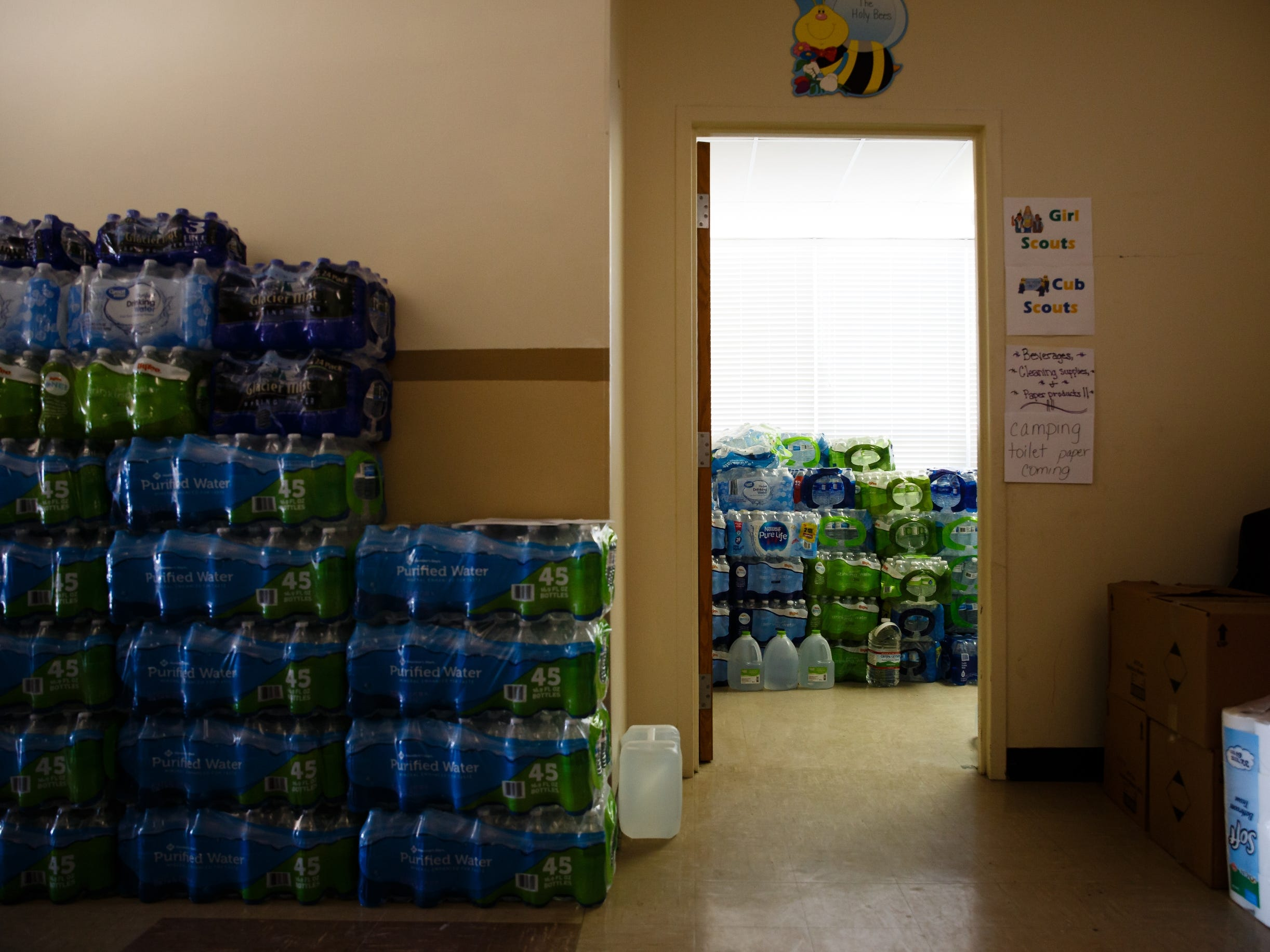 Bottled water is piled high in the basement of the Grace United Methodist Church for residents who have been displaced by the rising flood waters along the Missouri River on Wednesday, March 20, 2019, in Glenwood.