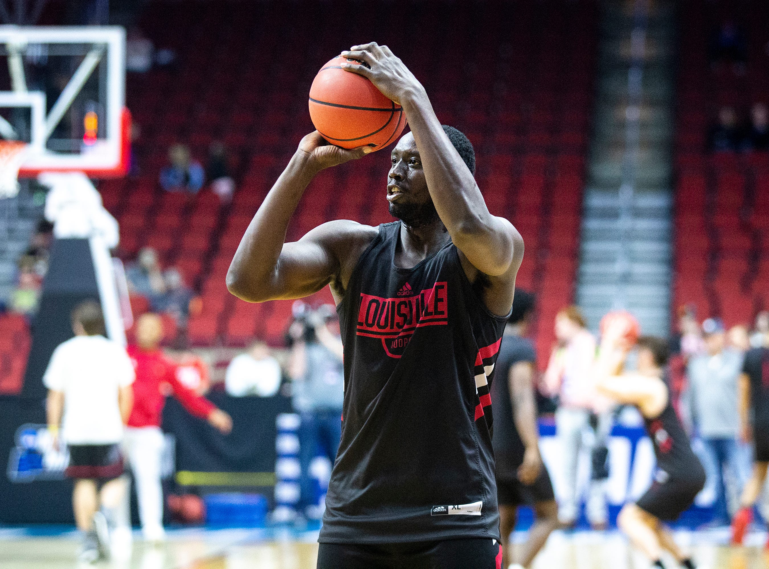 Louisville's Akoy Agau shoots the ball during Louisville's open practice before the first round of the NCAA Men's Basketball Tournament on Wednesday, March 20, 2019, at Wells Fargo Arena in Des Moines, Iowa.