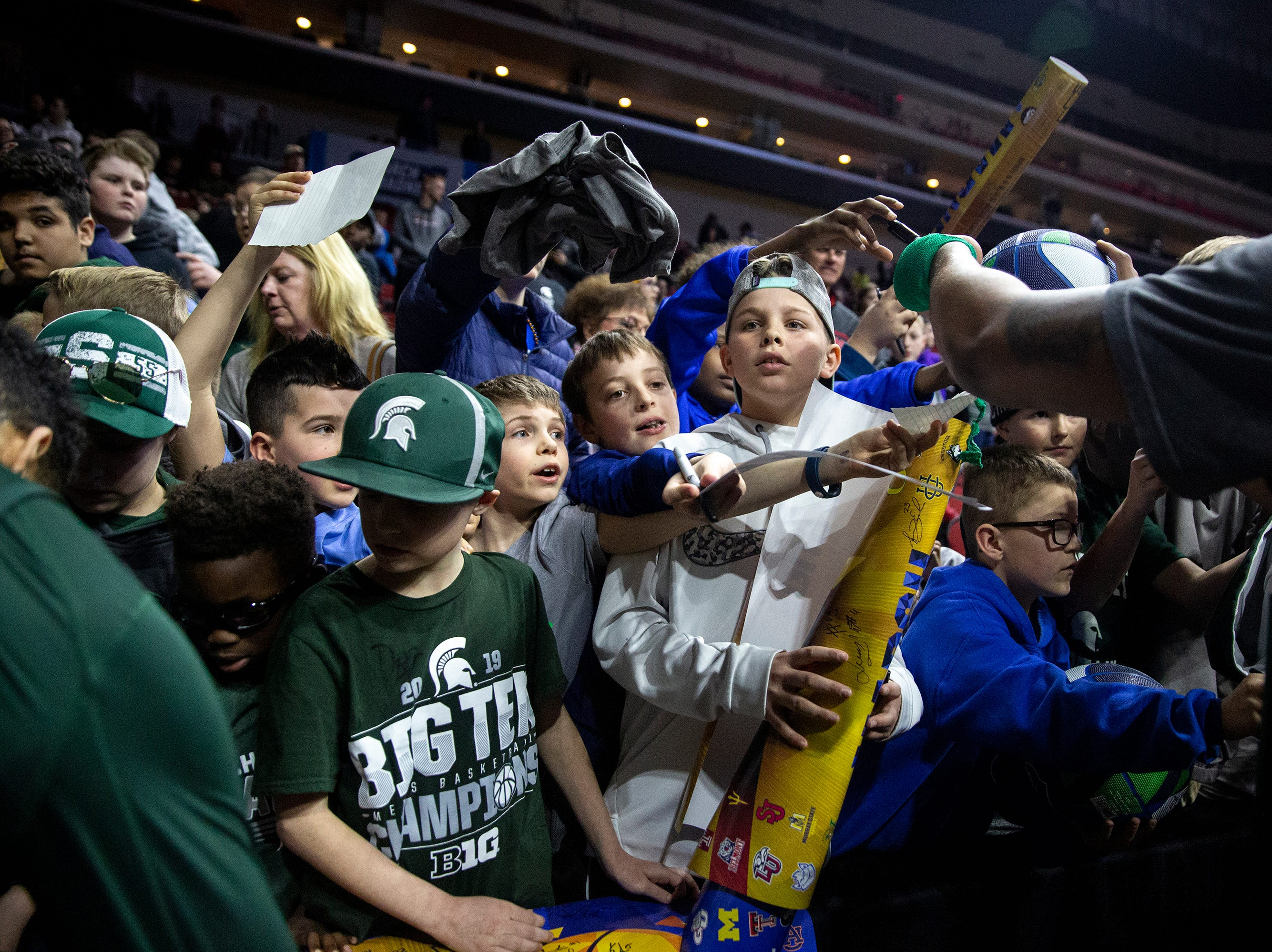 Eager fans wait for autographs from players during Michigan State's open practice before the first round of the NCAA Men's Basketball Tournament on Wednesday, March 20, 2019, at Wells Fargo Arena in Des Moines, Iowa.