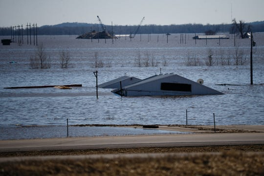 Buildings at the intersection of I-29 and Highway 34 are filled to their roofs with flood waters on Wednesday, March 20, 2019, in Mills County.