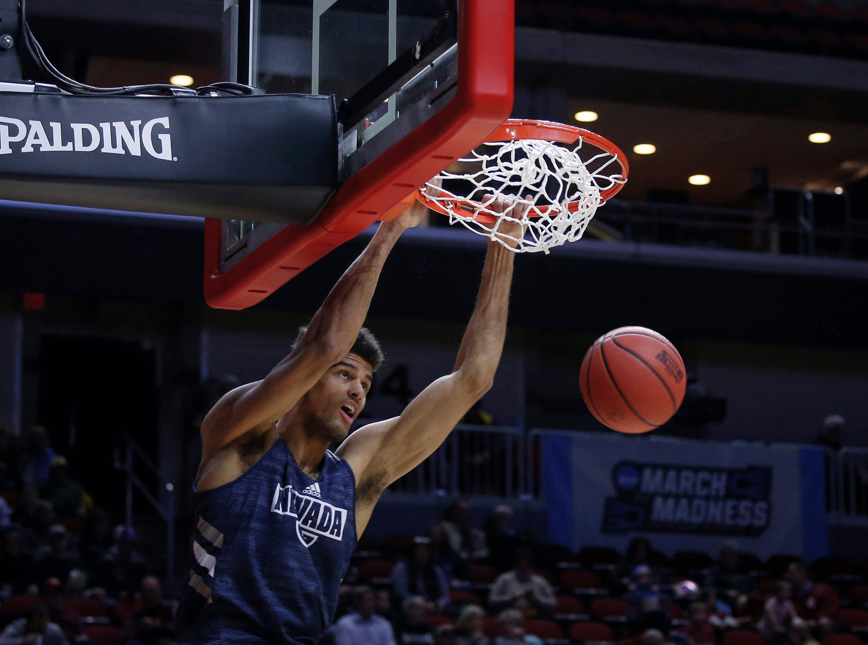 Nevada senior Trey Porter dunks the ball during open practice on Wednesday, March 20, 2019, at Wells Fargo Arena in Des Moines, Iowa.