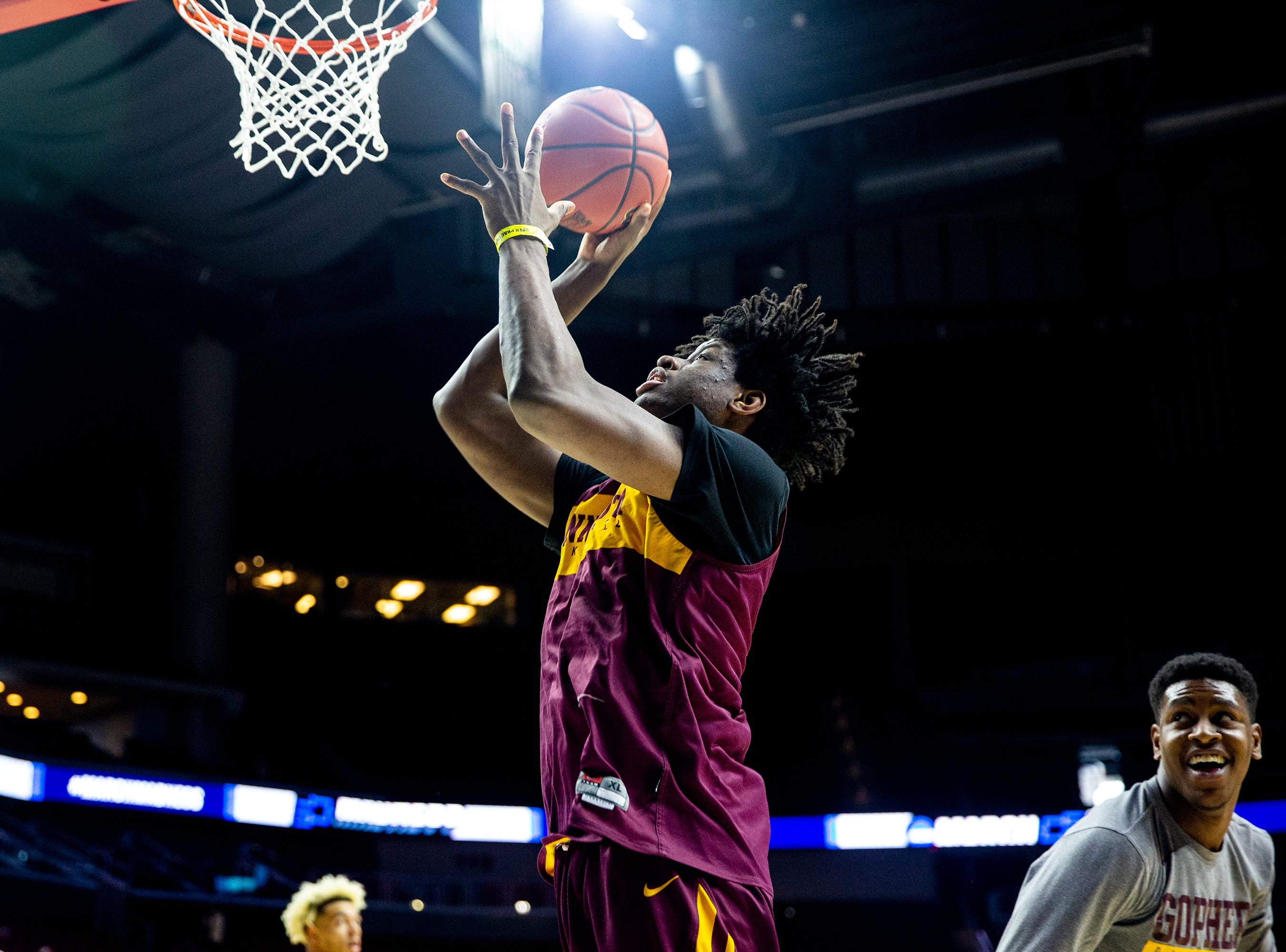 Minnesota's Daniel Oturu shoots a lay-up during Minnesota's open practice before the first round of the NCAA Men's Basketball Tournament on Wednesday, March 20, 2019, at Wells Fargo Arena in Des Moines, Iowa. Minnesota will face Louisville in the first round on Thursday.