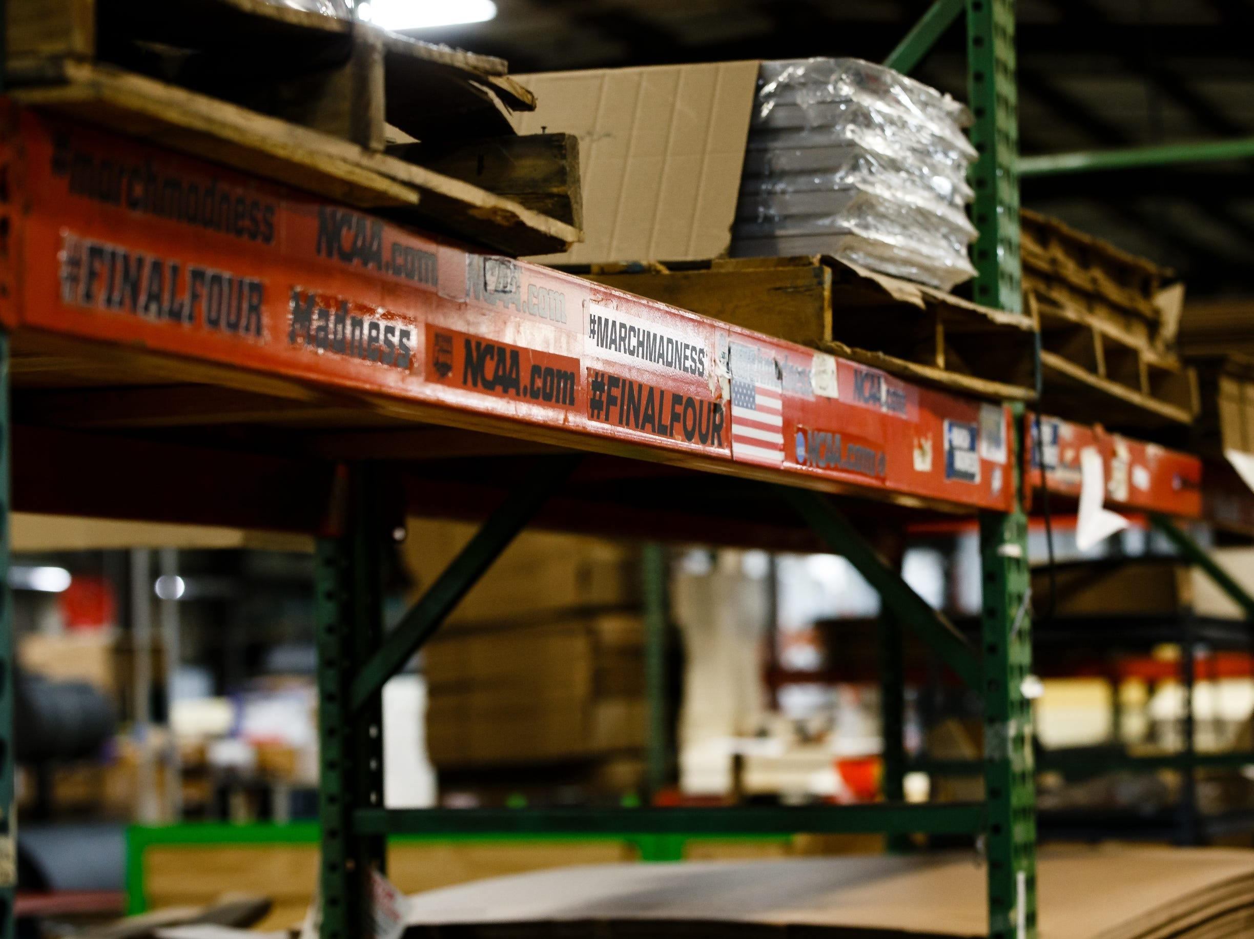 Stickers and decals adorn shelving at the AAI facility in Jefferson on Wednesday, March 13, 2019. AAI is the official supplier of basketball back stops for NBA, NCAA, WNBA and the NBA G-League. They make all their products, as well as a full line of gymnastics and tumbling equipment out of this factory in Jefferson where they were founded.