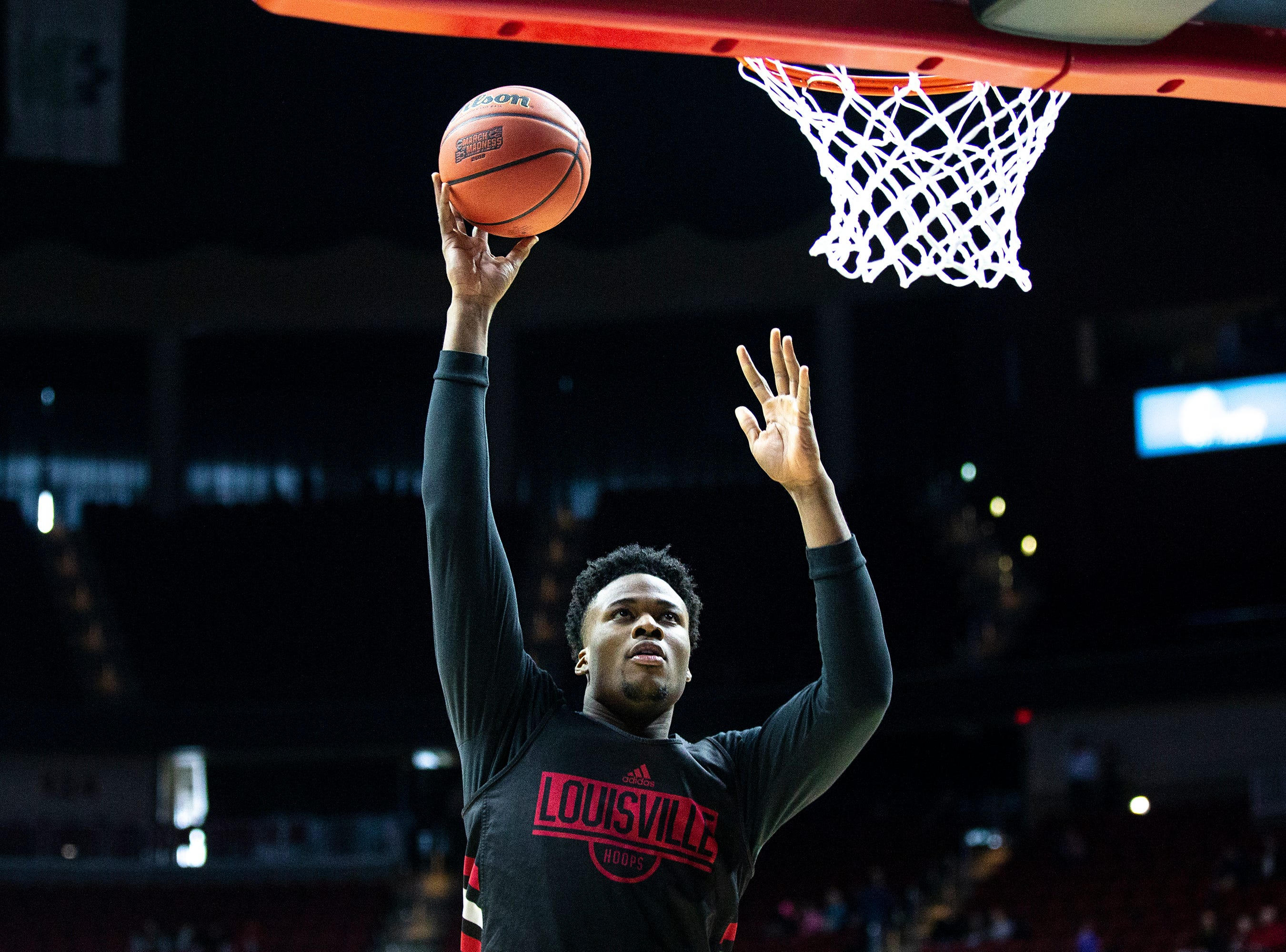 Louisville's Steven Enoch  shoots the ball during Louisville's open practice before the first round of the NCAA Men's Basketball Tournament on Wednesday, March 20, 2019, at Wells Fargo Arena in Des Moines, Iowa.