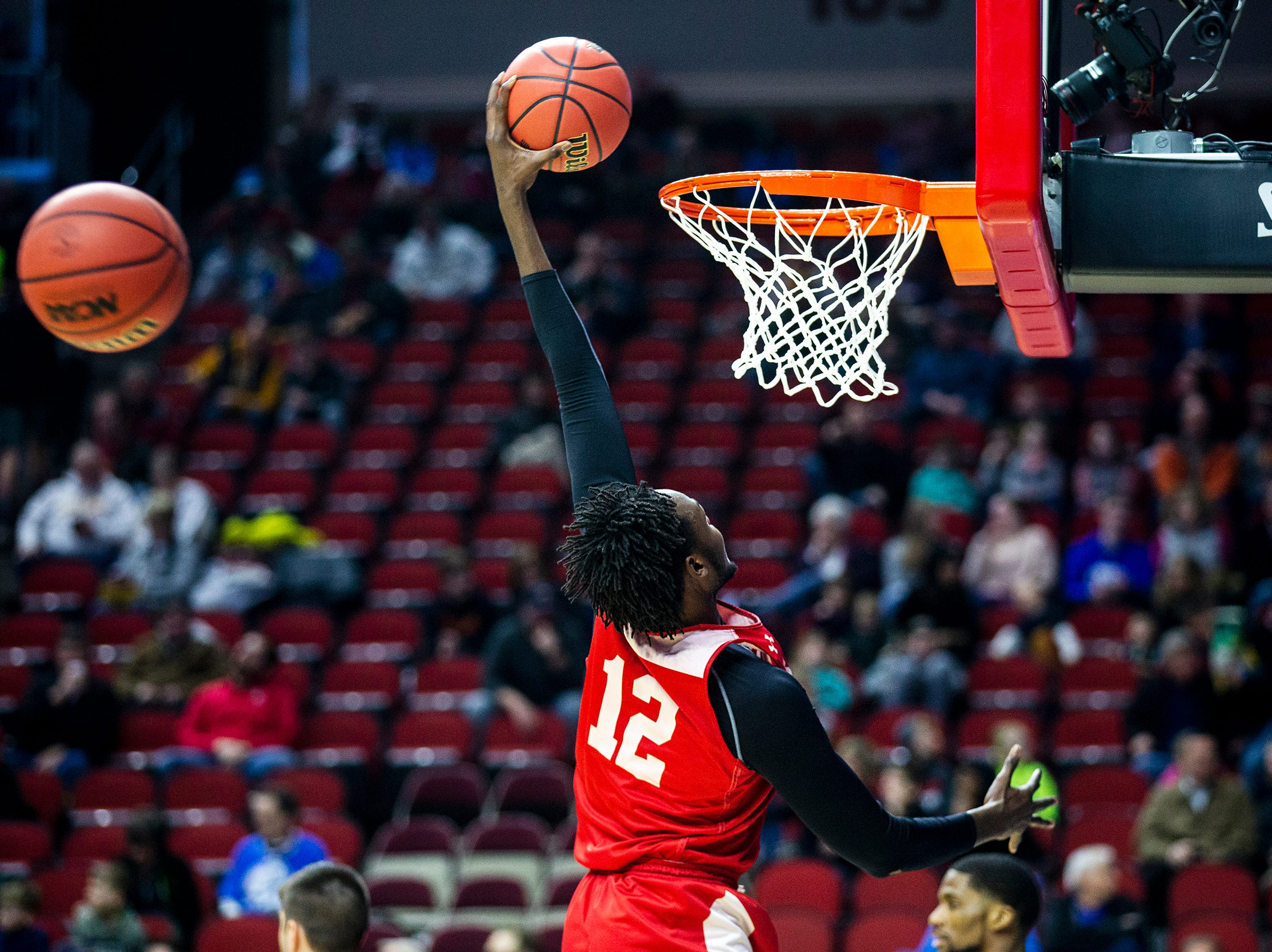 Bradley's Koch Bar dunks the ball during Bradley's open practice before the first round of the NCAA Men's Basketball Tournament on Wednesday, March 20, 2019, at Wells Fargo Arena in Des Moines, Iowa.