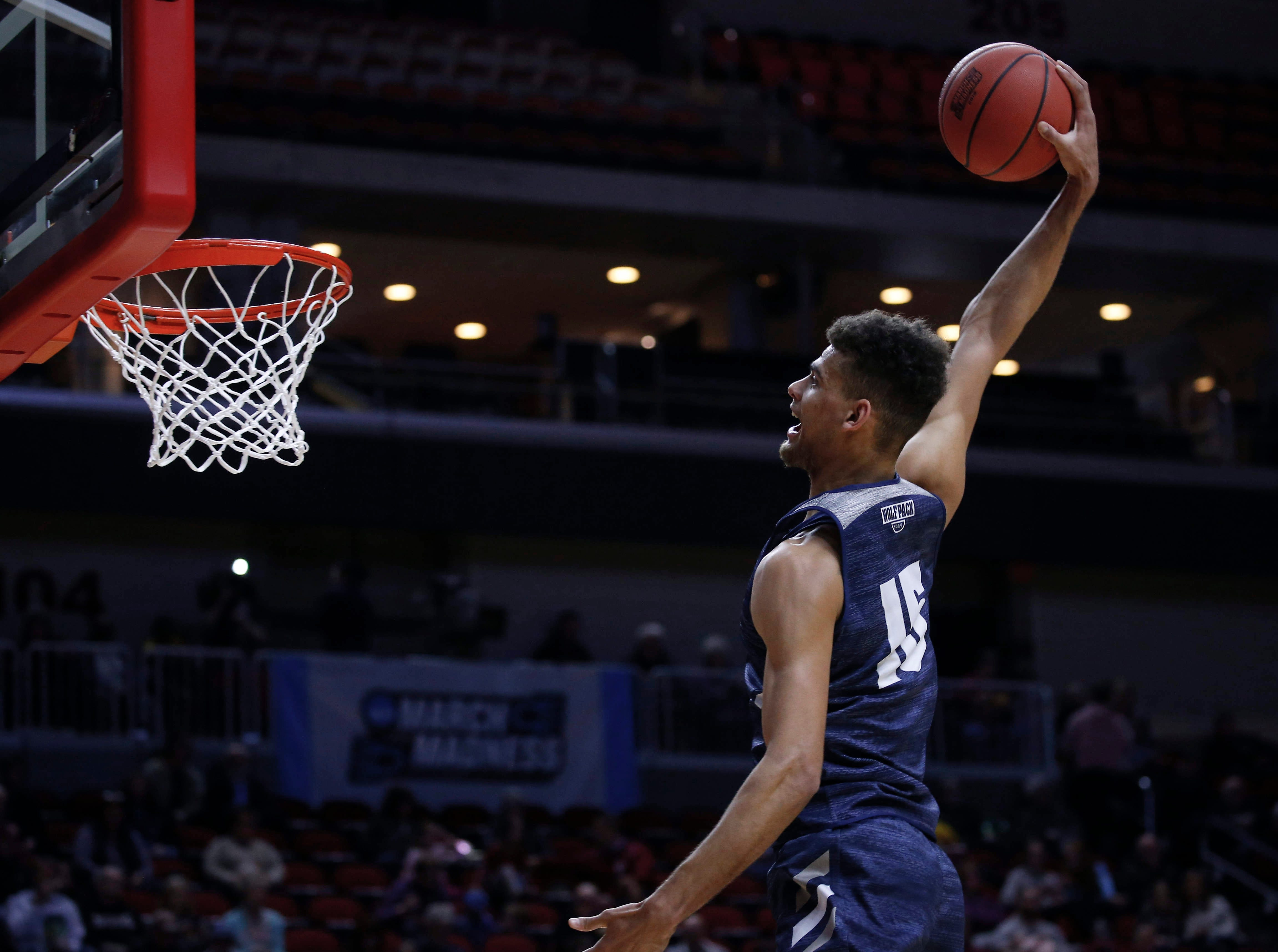 Nevada freshman Trey Porter soars to the hoop to dunk the ball during open practice on Wednesday, March 20, 2019, at Wells Fargo Arena in Des Moines, Iowa.