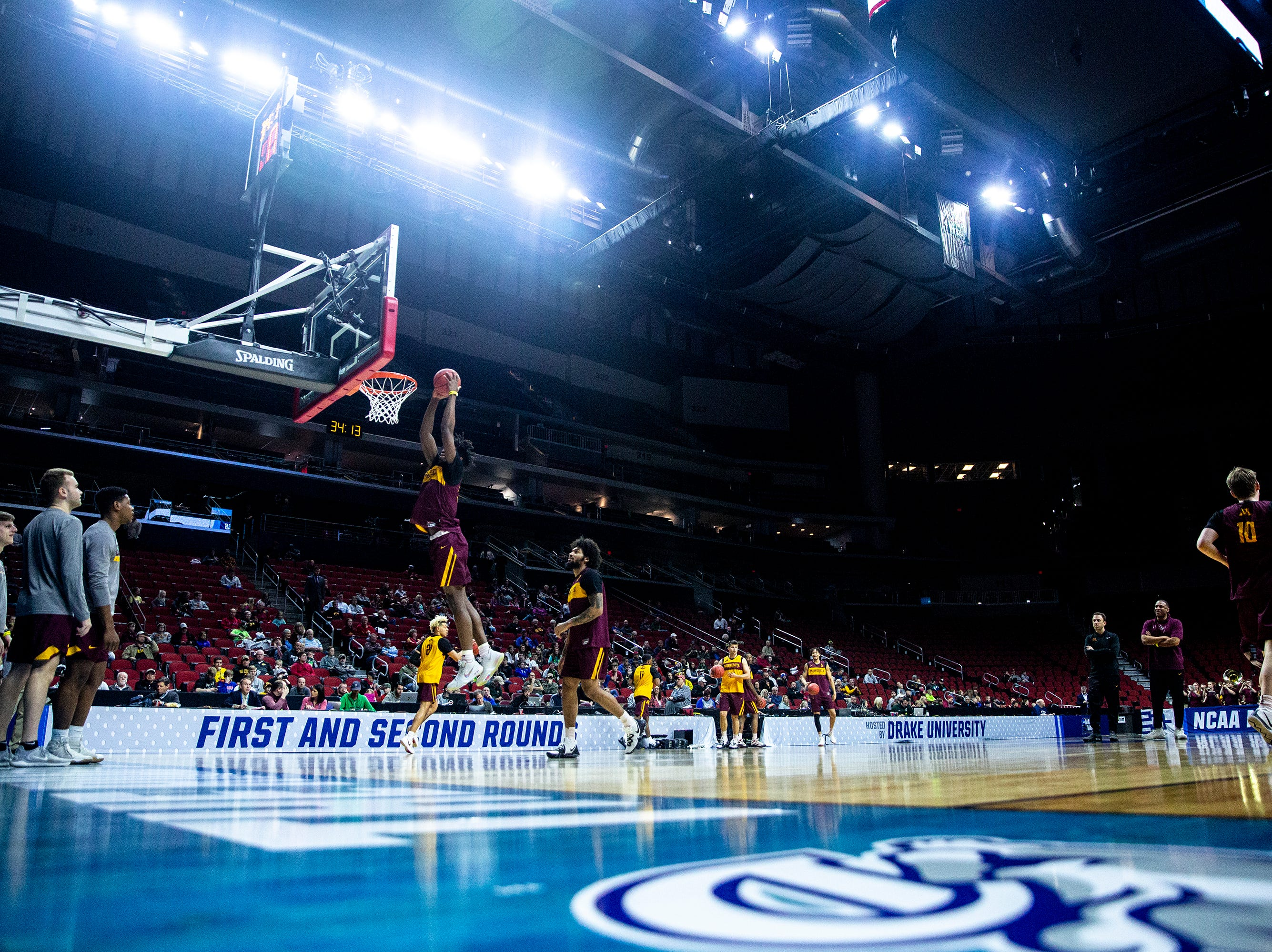Plays run through shooting drills during Minnesota's open practice before the first round of the NCAA Men's Basketball Tournament on Wednesday, March 20, 2019, at Wells Fargo Arena in Des Moines, Iowa. Minnesota will face Louisville in the first round on Thursday.