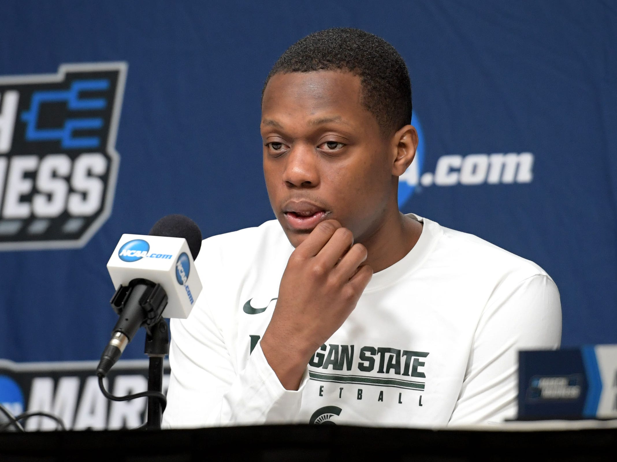 Mar 20, 2019; Des Moines, IA, USA; Michigan State Spartans guard Cassius Winston (5) speaks in a press conference during practice before the first round of the 2019 NCAA Tournament at Wells Fargo Arena. Mandatory Credit: Steven Branscombe-USA TODAY Sports