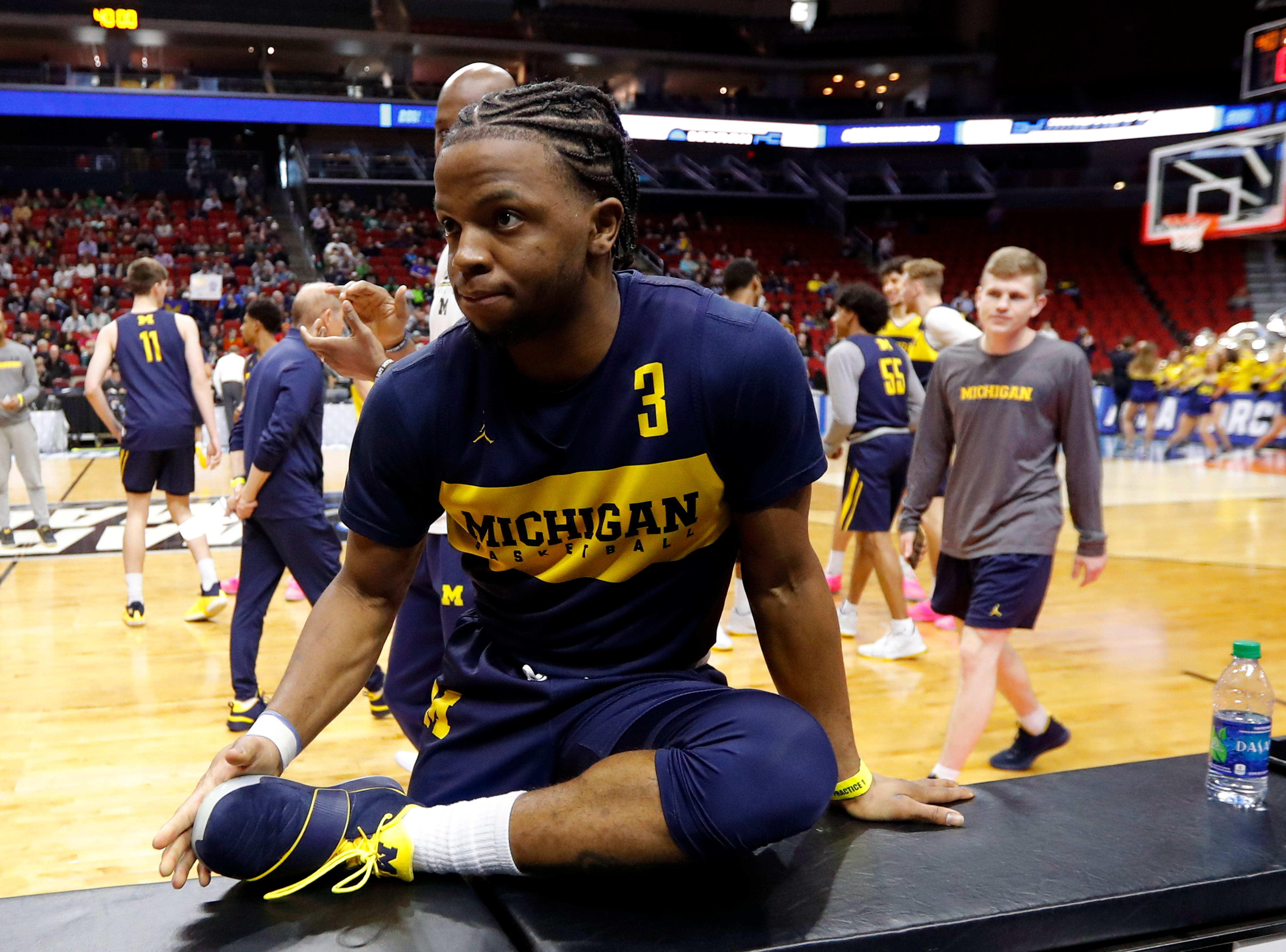 Michigan guard Zavier Simpson stretches during practice at the NCAA men's college basketball tournament, Wednesday, March 20, 2019, in Des Moines, Iowa. Michigan plays Montana on Thursday. (AP Photo/Charlie Neibergall)