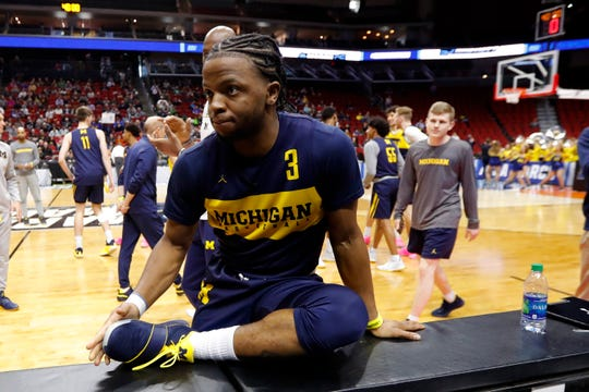 Zavier Simpson stretches during practice Wednesday.