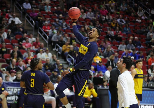 Michigan's Charles Matthews takes a shot during practice for their first round NCAA tournament game against Montana, March 20, 2019 at Wells Fargo Arena in Des Moines, Iowa.