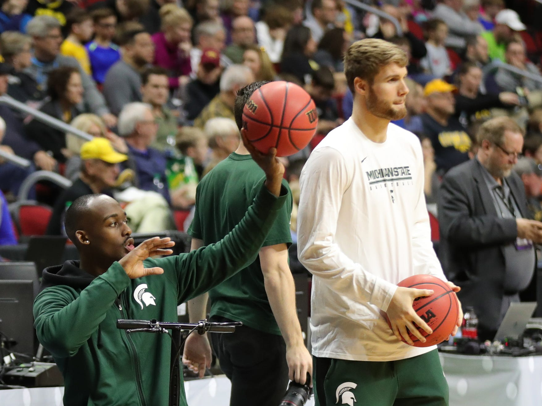 Injured Michigan State players Joshua Langford and Kyle Ahrens watch drills as the team prepares for the first-round NCAA tournament game against Michigan State on Wednesday, March 20, 2019 at Wells Fargo Arena in Des Moines, Iowa.