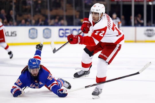 Andreas Athanasiou scores an empty net goal in front of Rangers center Mika Zibanejad during the third period at Madison Square Garden, March 19.