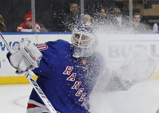 Henrik Lundqvist #30 of the New York Rangers tends net against the Detroit Red Wings during the first period at Madison Square Garden on March 19, 2019 in New York City. With playing 18:38 minutes, Lundqvist has played 50,000 minutes in his NHL career and became the third goaltender to accomplish that feat with one franchise in NHL history. Martin Brodeur of New Jersey and Tony Esposito of Chicago are the others. The Red Wings defeated the Rangers 3-2.