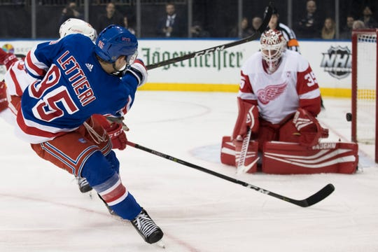 Detroit Red Wings goaltender Jimmy Howard (35) makes the save against New York Rangers center Vinni Lettieri (95) during the second period of an NHL hockey game, Tuesday, March 19, 2019, at Madison Square Garden in New York.