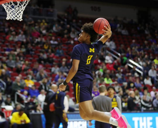Michigan guard Jordan Poole dunks during practice for their first round NCAA Tournament game against Montana Wednesday, March 20, 2019 at Wells Fargo Arena in Des Moines, Iowa.