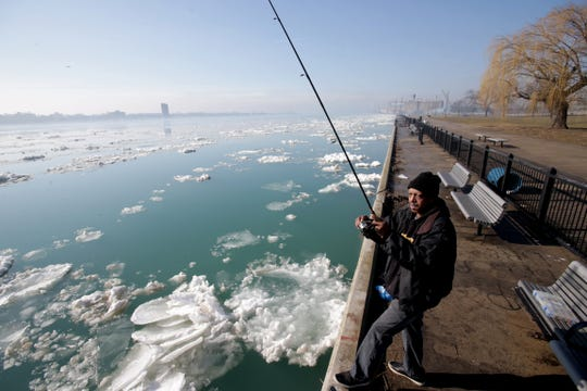 Ronnie Gotcher, 59, of Detroit, fishes for walleye on the Detroit River on  Tuesday, March 21, 2017. Walleye are a cool-water species that could be negatively impacted by warming waters due to climate change, a new report by university and other researchers finds. The report was published by the Environmental Law and Policy Center.
