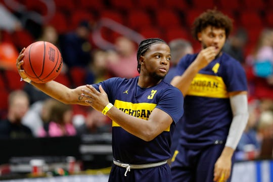 Michigan guard Zavier Simpson passes the ball during practice at the NCAA men's college basketball tournament, Wednesday, March 20, 2019, in Des Moines, Iowa. Michigan plays Montana on Thursday. (AP Photo/Charlie Neibergall)