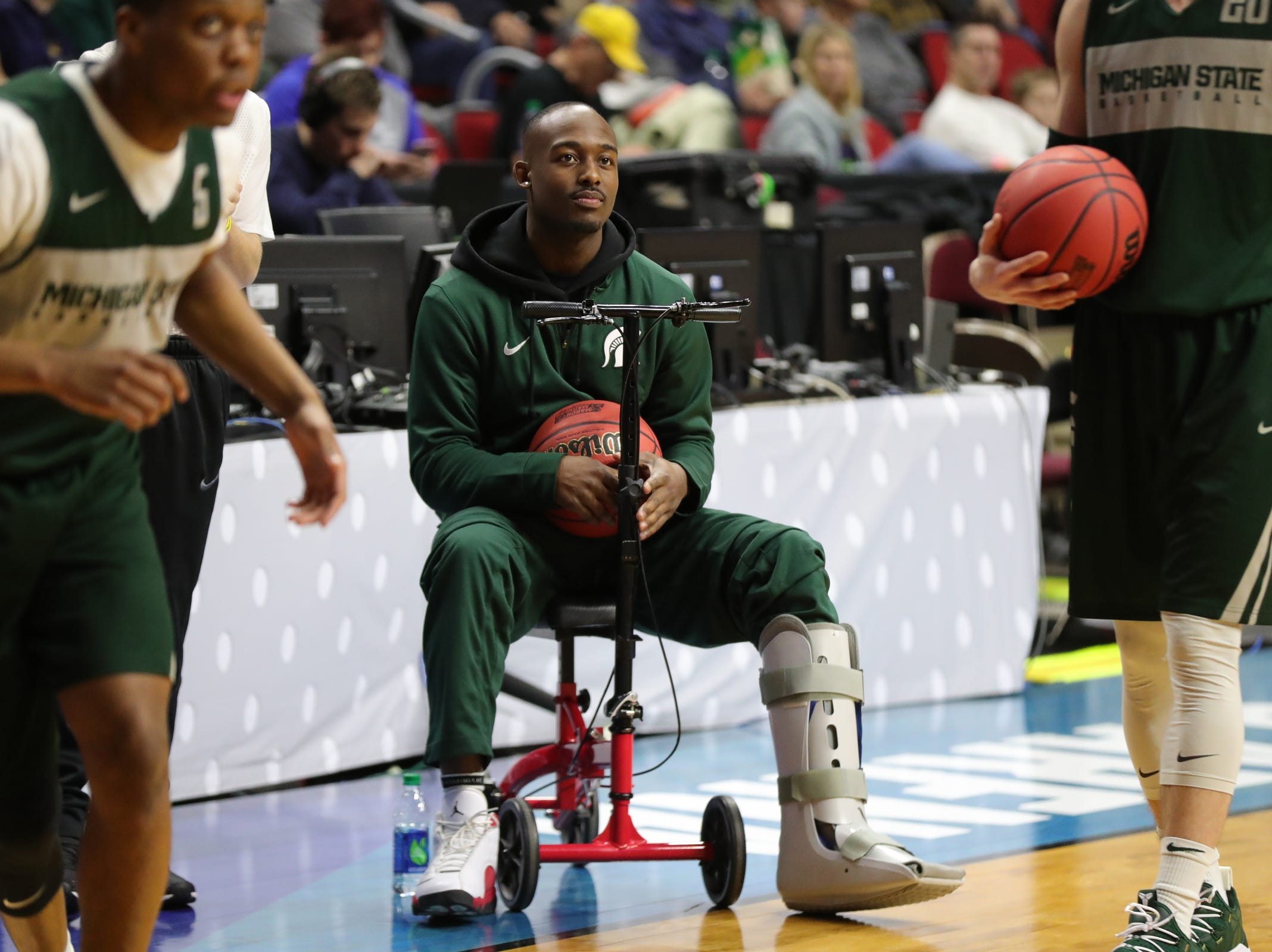 Injured Michigan State player Joshua Langford watches drills as the team prepares for the first-round NCAA tournament game against Michigan State on Wednesday, March 20, 2019 at Wells Fargo Arena in Des Moines, Iowa.