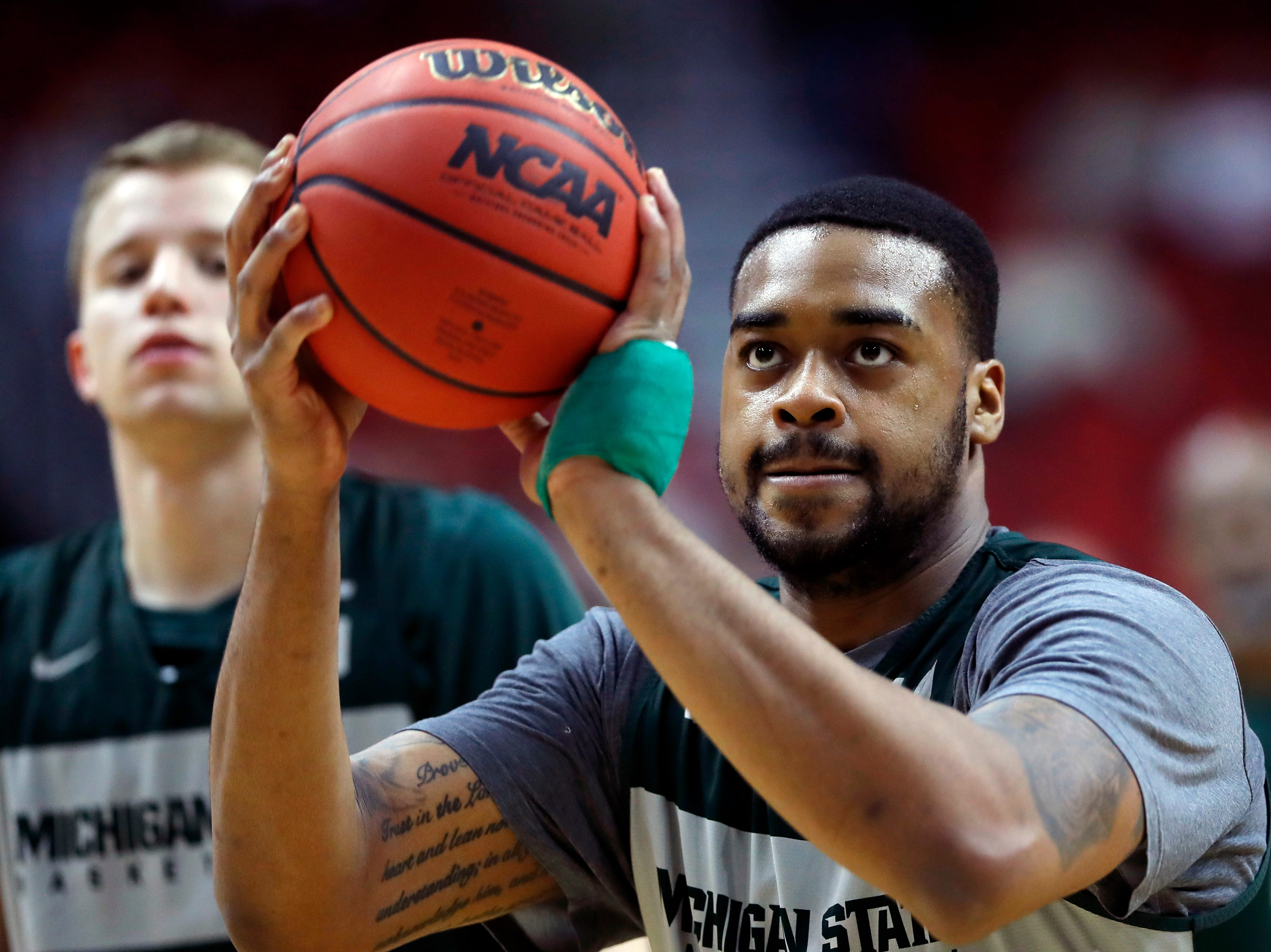 Michigan State forward Nick Ward shoots a free throw during practice at the NCAA men's college basketball tournament, Wednesday, March 20, 2019, in Des Moines, Iowa. Michigan State plays Bradley on Thursday. (AP Photo/Charlie Neibergall)