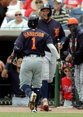 Tigers second Baseman Josh Harrison (1) celebrates with Miguel Cabrera after Harrison hit a home race against Philadelphia Phillies pitcher Nick Pivetta during the third inning of a spring training baseball game on Wednesday, March 20, 2019 in Clearwater, Fla.