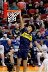 Michigan's Jordan Poole (2) shoots during practice at the NCAA college basketball tournament in Des Moines, Iowa, Wednesday, March 20, 2019. (AP Photo/Nati Harnik)