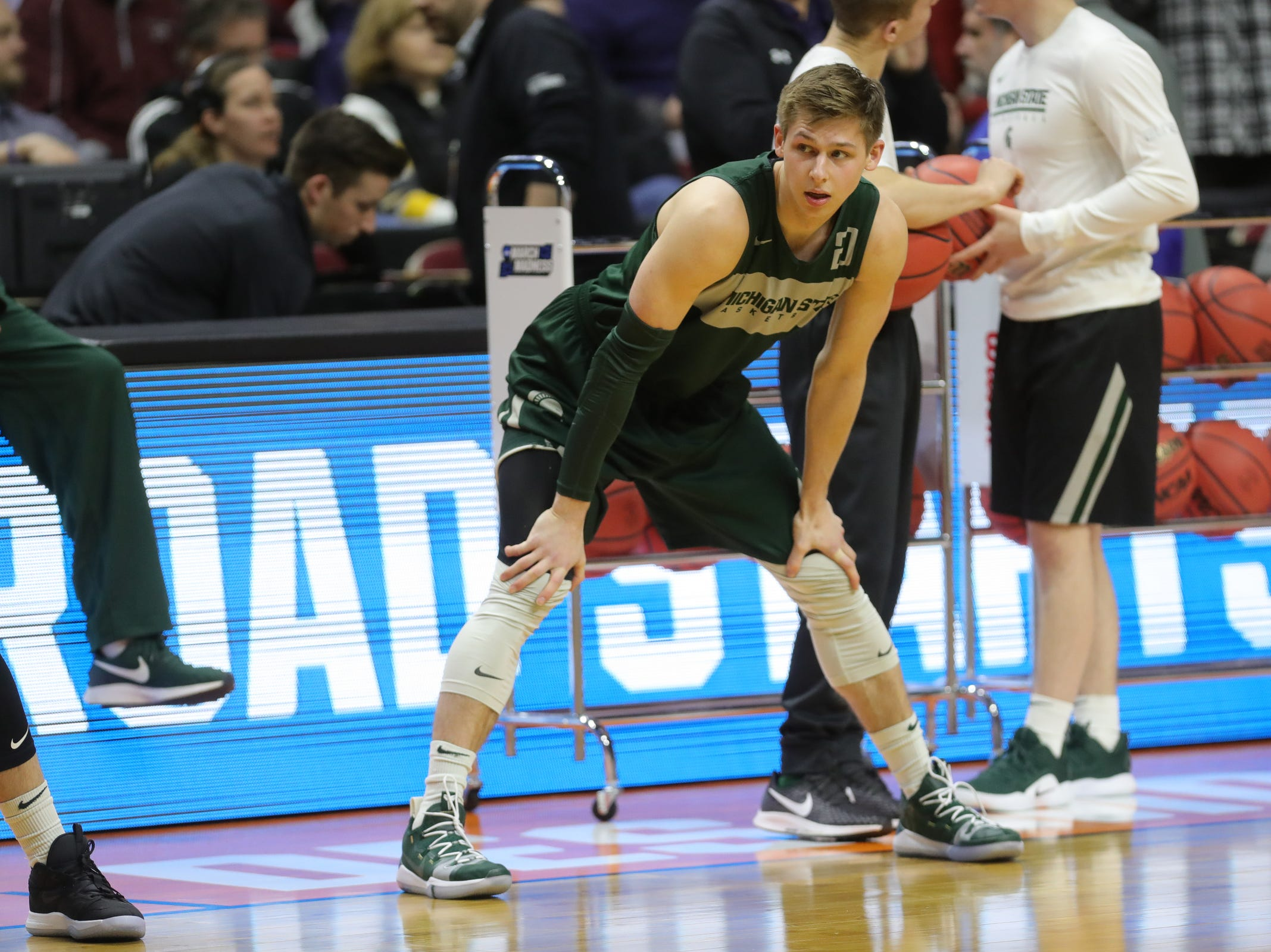Michigan State guard Matt McQuaid goes through drills as his team prepares their first round the NCAA Tournament game against Bradley Wednesday, March 20, 2019 at Wells Fargo Arena in Des Moines, IA.